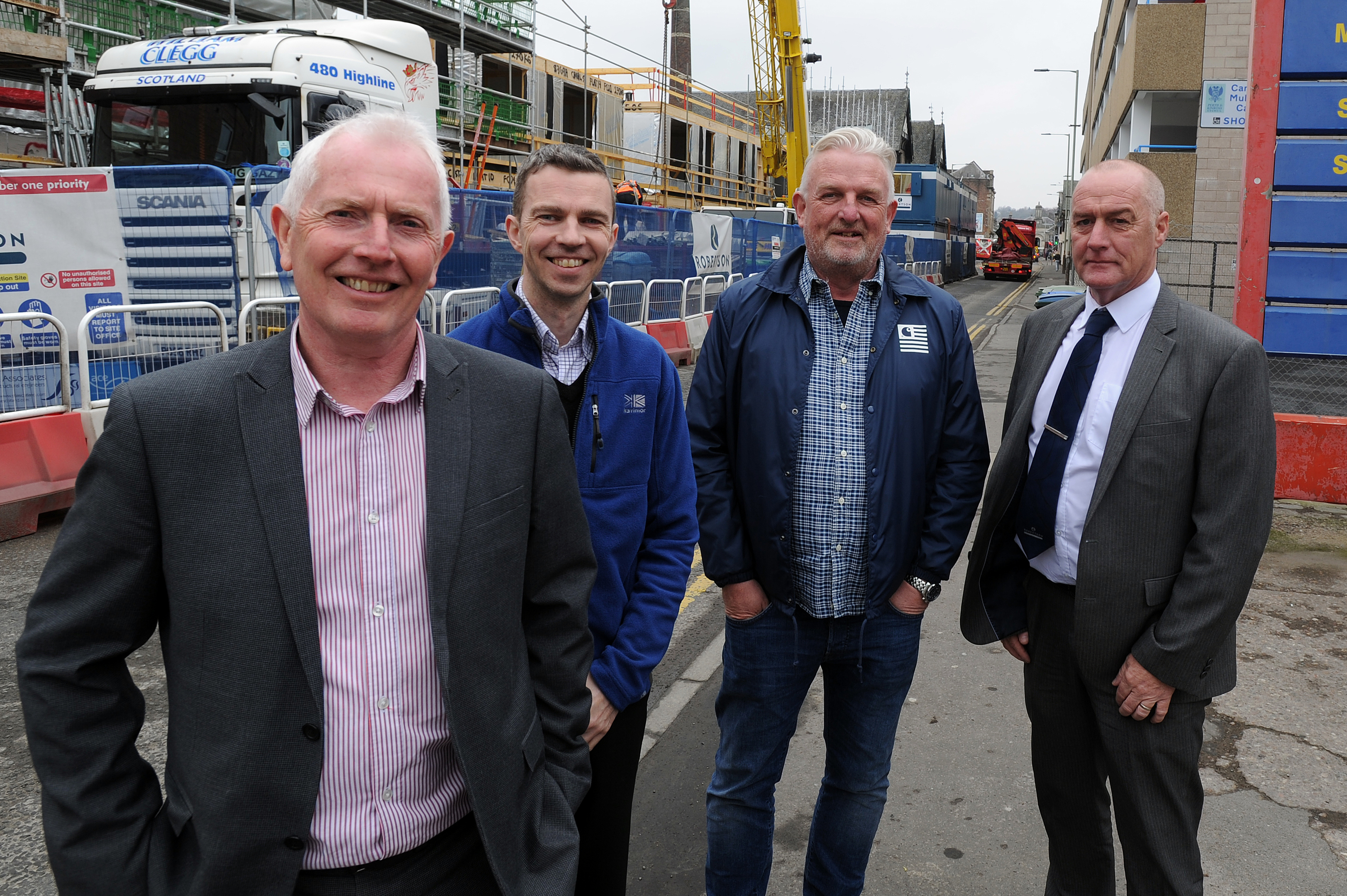 Work on the  housing development on Canal Street, Perth has re-started. From left,  Hamish Bell (quantity surveyor), Barry Lees (Fairfield Housing), Grant Ager (chief executive Fairfield Housing) and Richard Law (Robertson Partnership Homes).