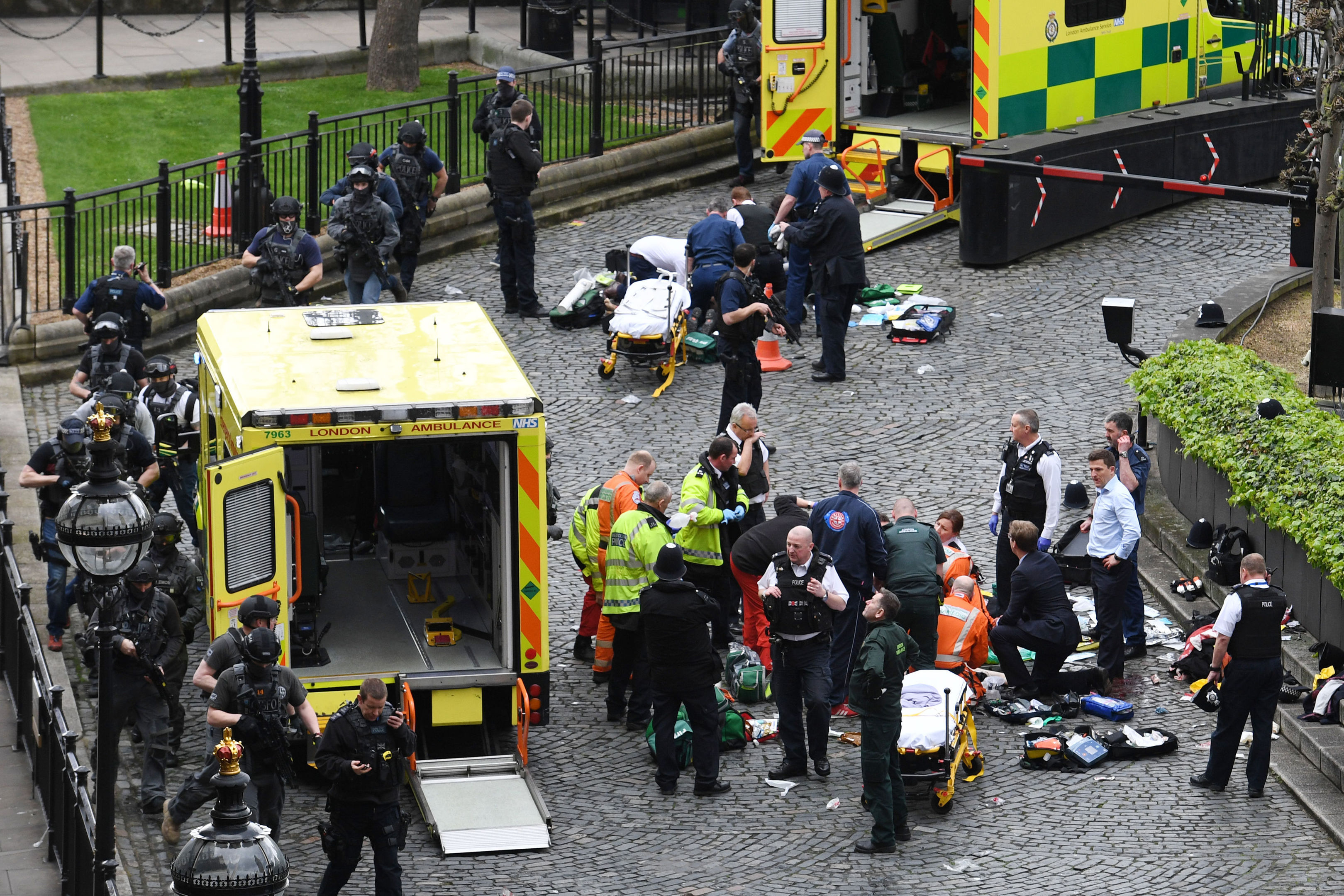 Paramedics treat wounded even as anti-terror police take up positions.
