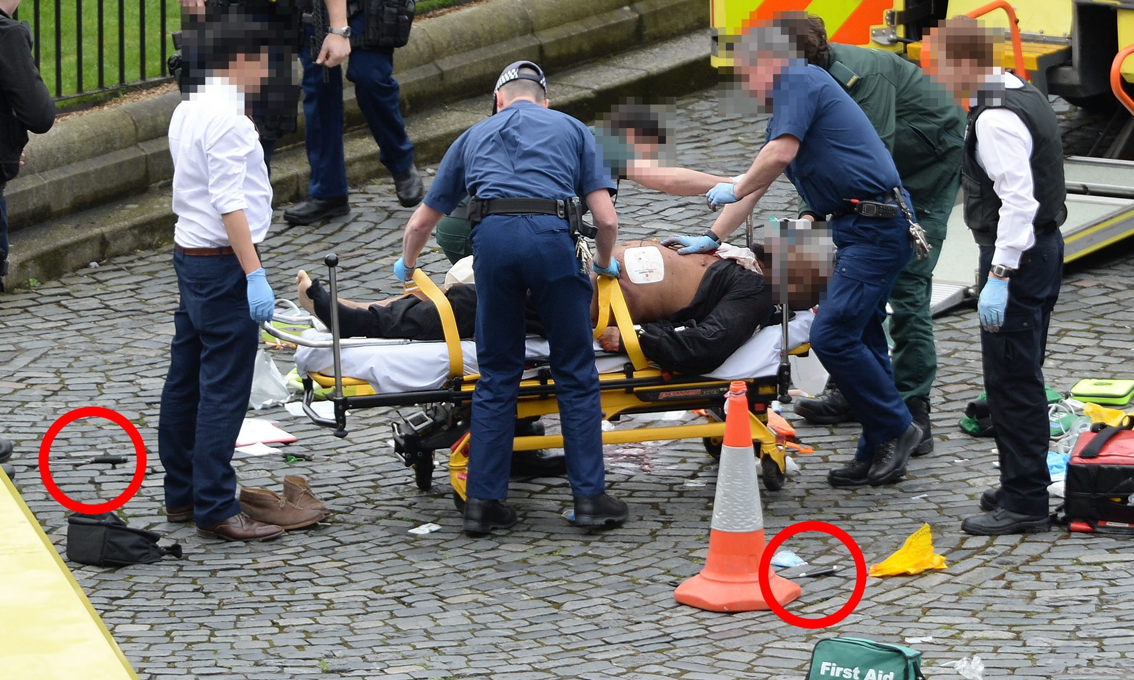 The suspected attacker, with knives highlighted on the ground.
