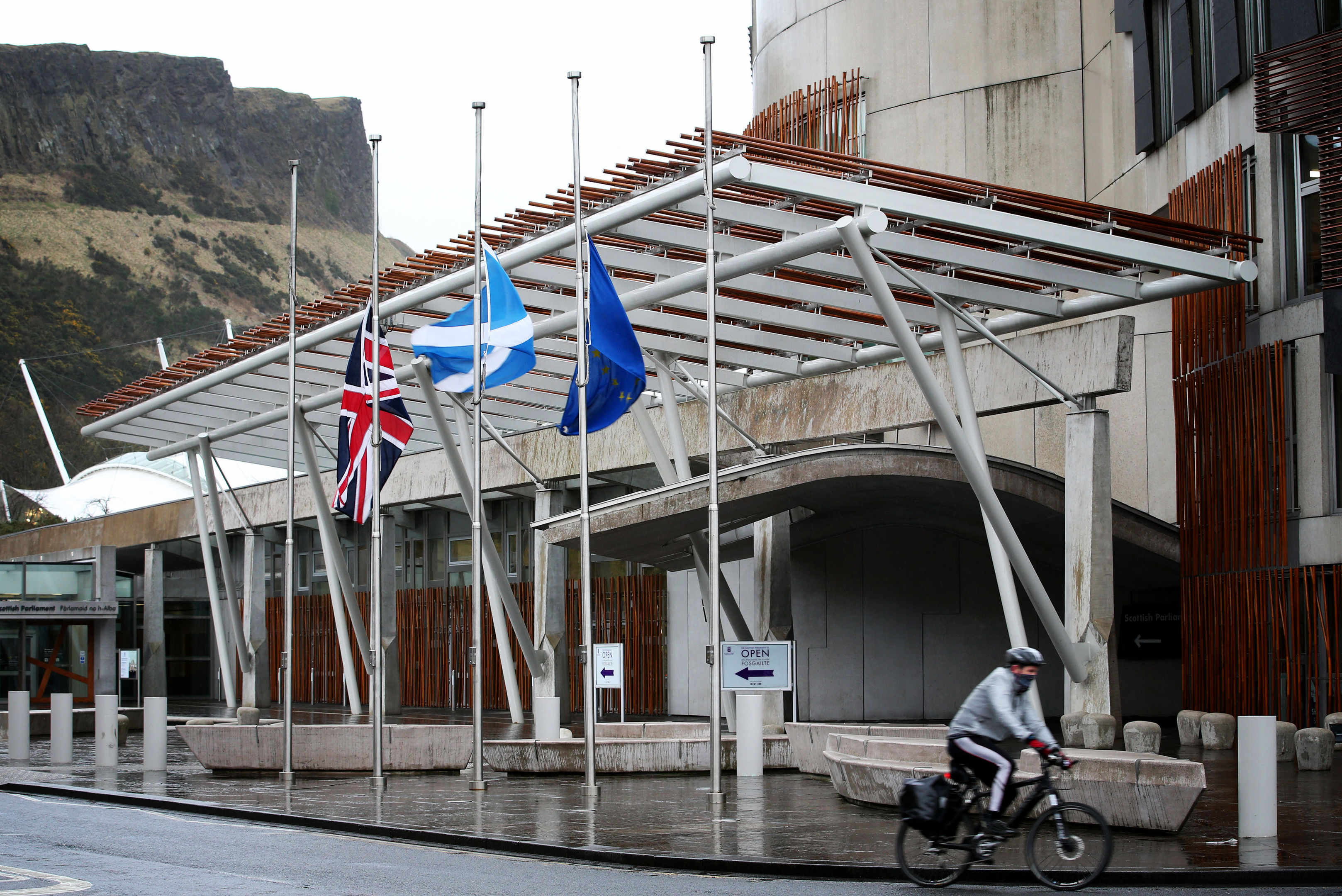 Flags fly at half-mast outside the Scottish Parliament.