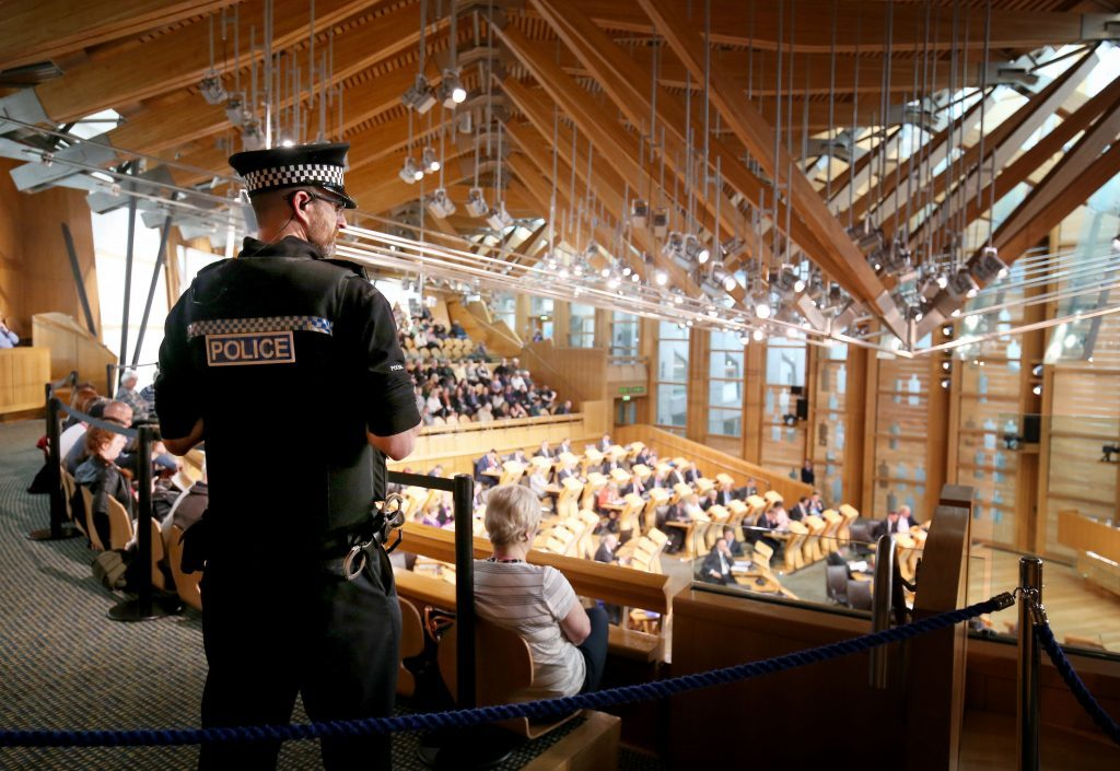 Police presence in the main chamber at the Scottish Parliament in Edinburgh, on the  second day of the debate on a potential second Scottish independence referendum.