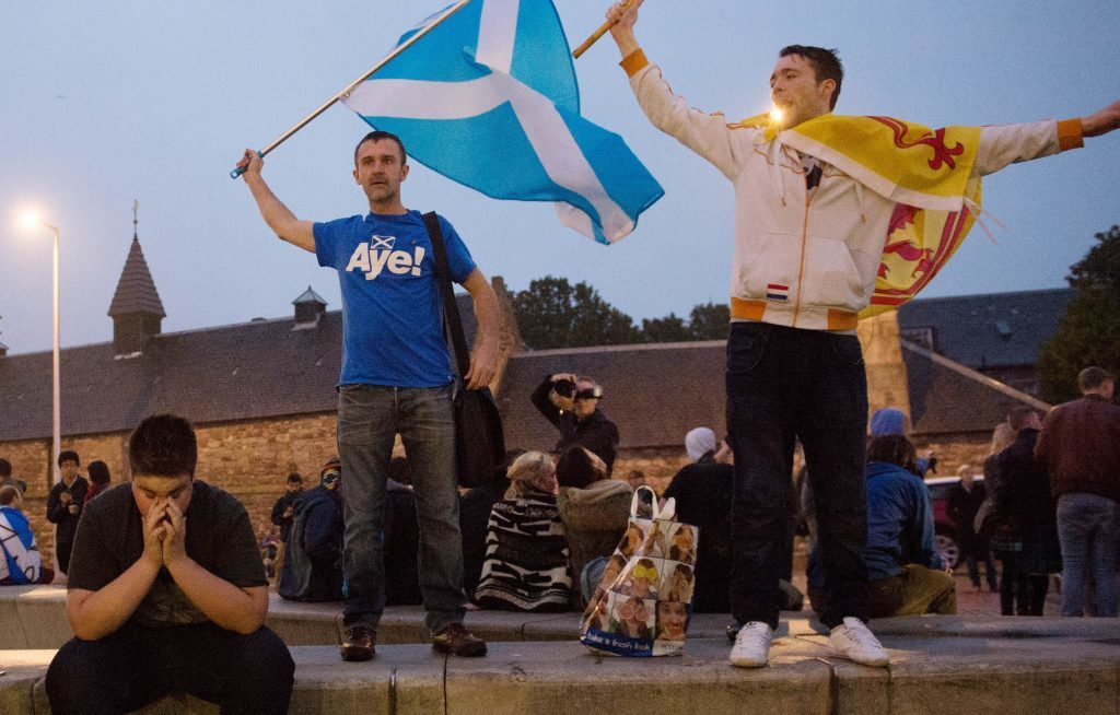 Defiant 'Yes' supporters in Edinburgh in the early hours after Scotland voted decisively to reject independence and remain part of the UK in September 2014.