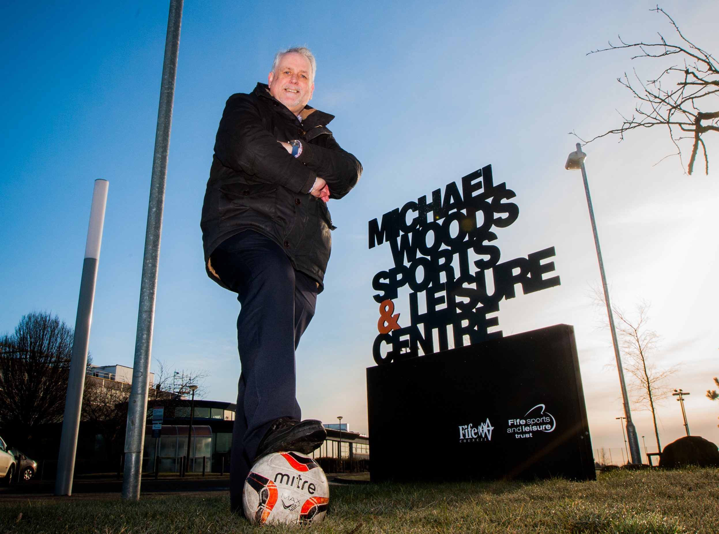 Councillor Bill Brown visits site near the development of new indoor football academy.