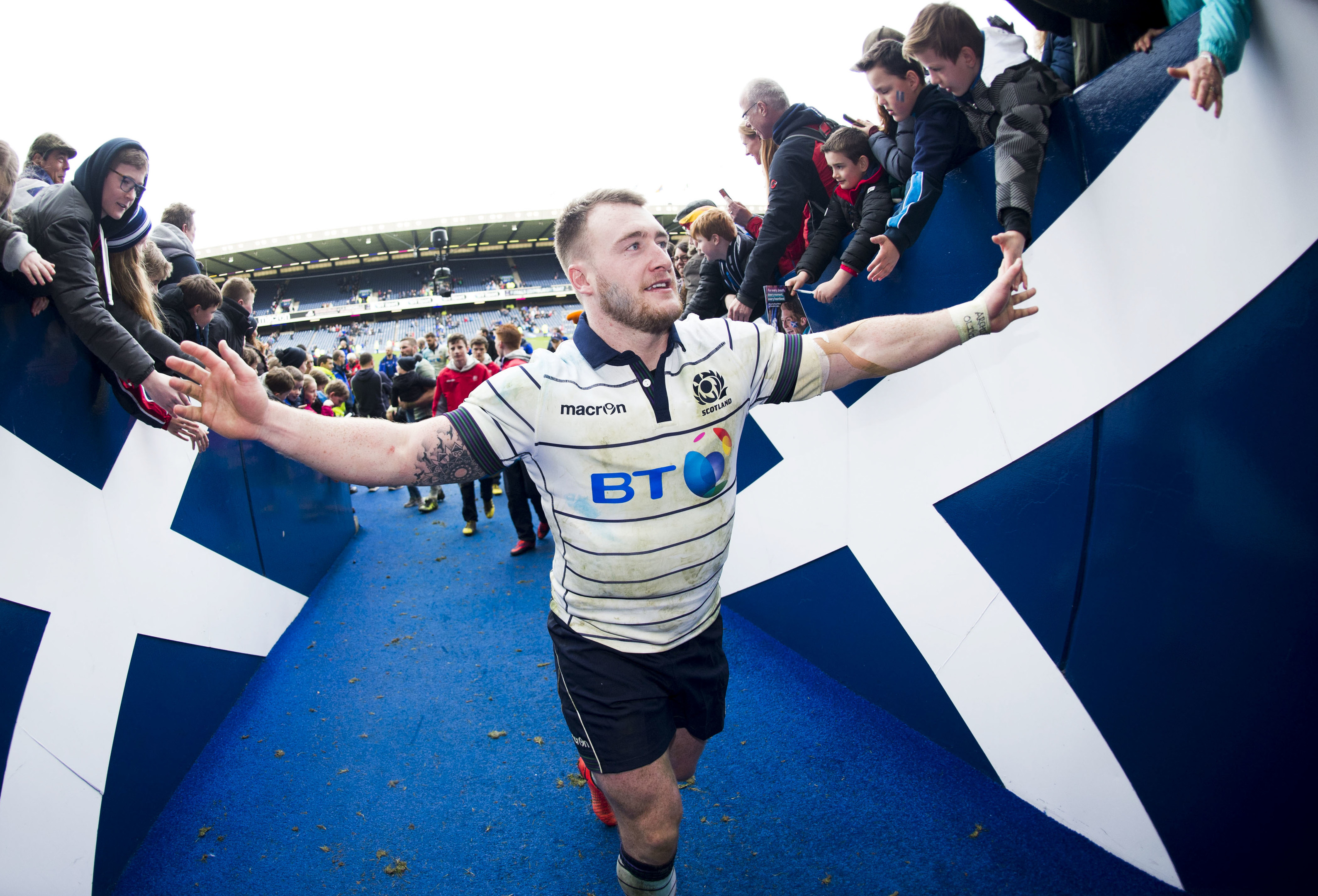 Stuart Hoggtakes the congratulations of Scotland fans as he leaves the field after the win over Italy.