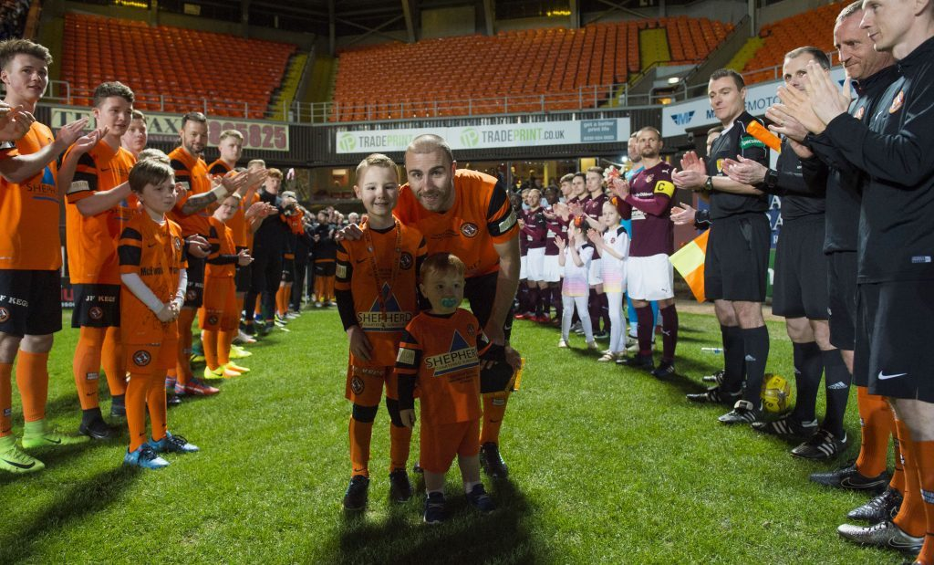 Sean Dillon walks out with his kids to a guard of honour at his testimonial match