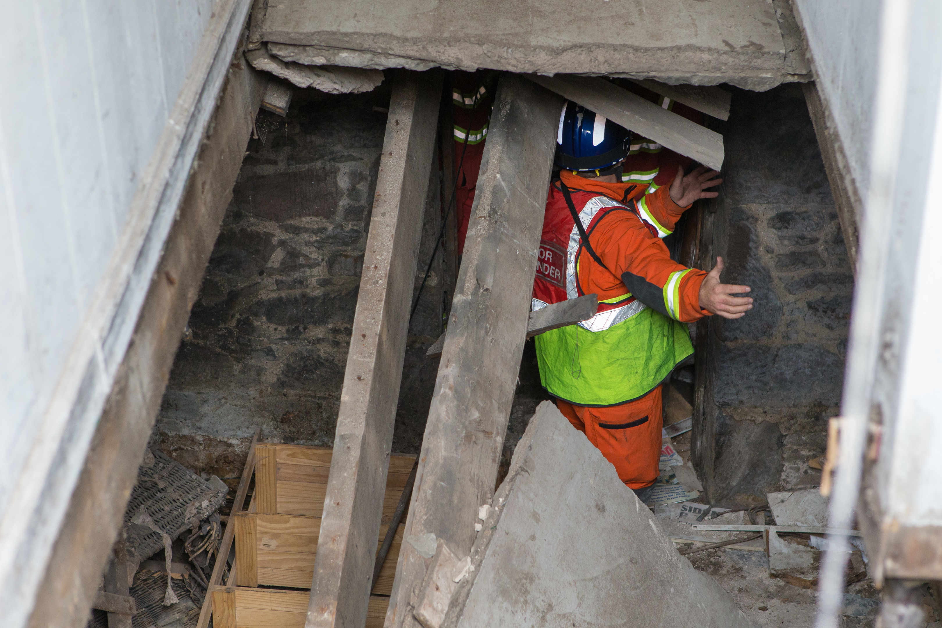 Emergency services down underneath the collapsed entranceway on Atholl Street,