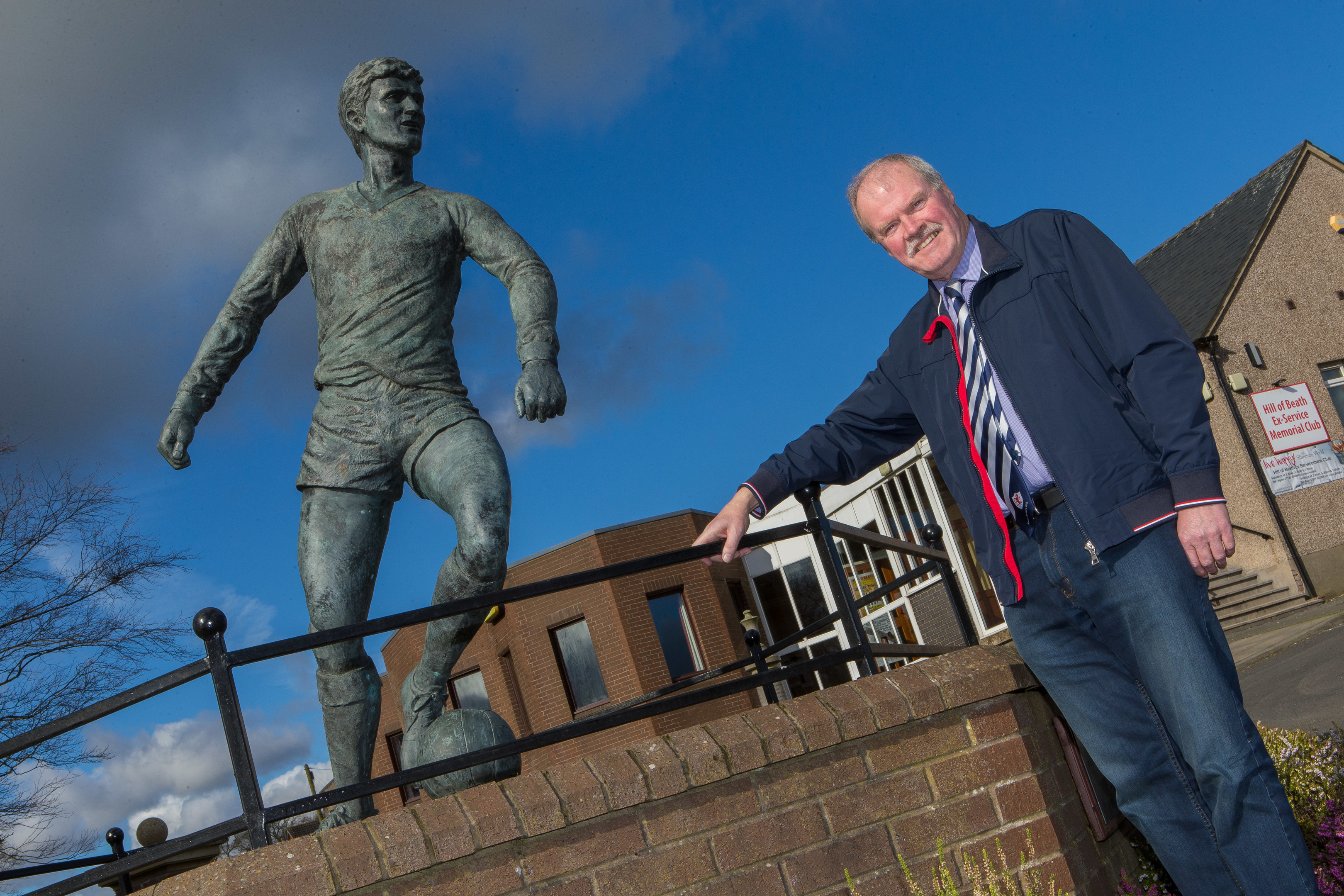 Raith director Dave Wann alongside the famous statue of Jim Baxter in Hill of Beath.
