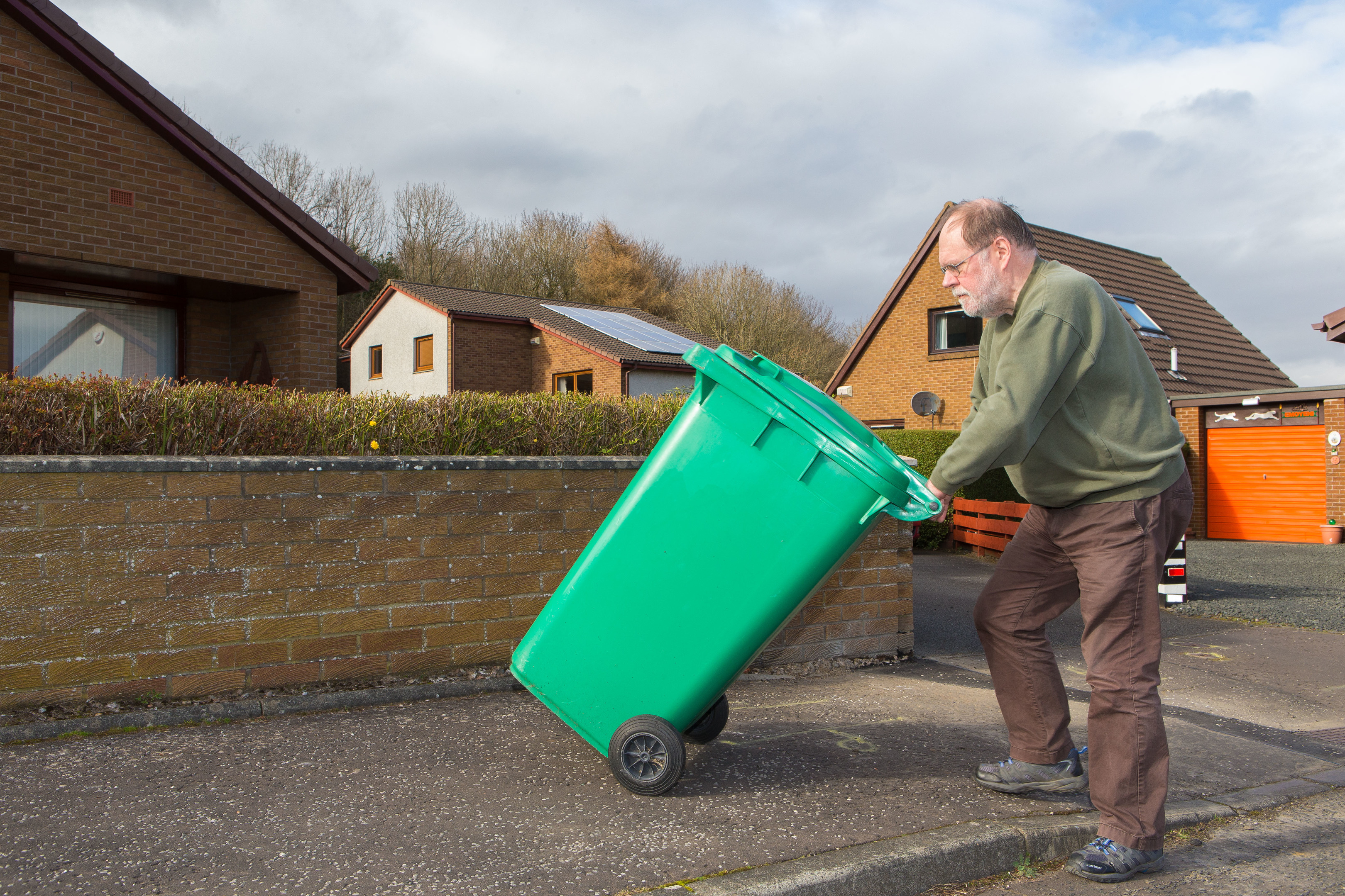 Councillor Dave Dempsey is proposing the council supply a solution to stop the rubbish emptying into the street when the bins are blown over in the wind.