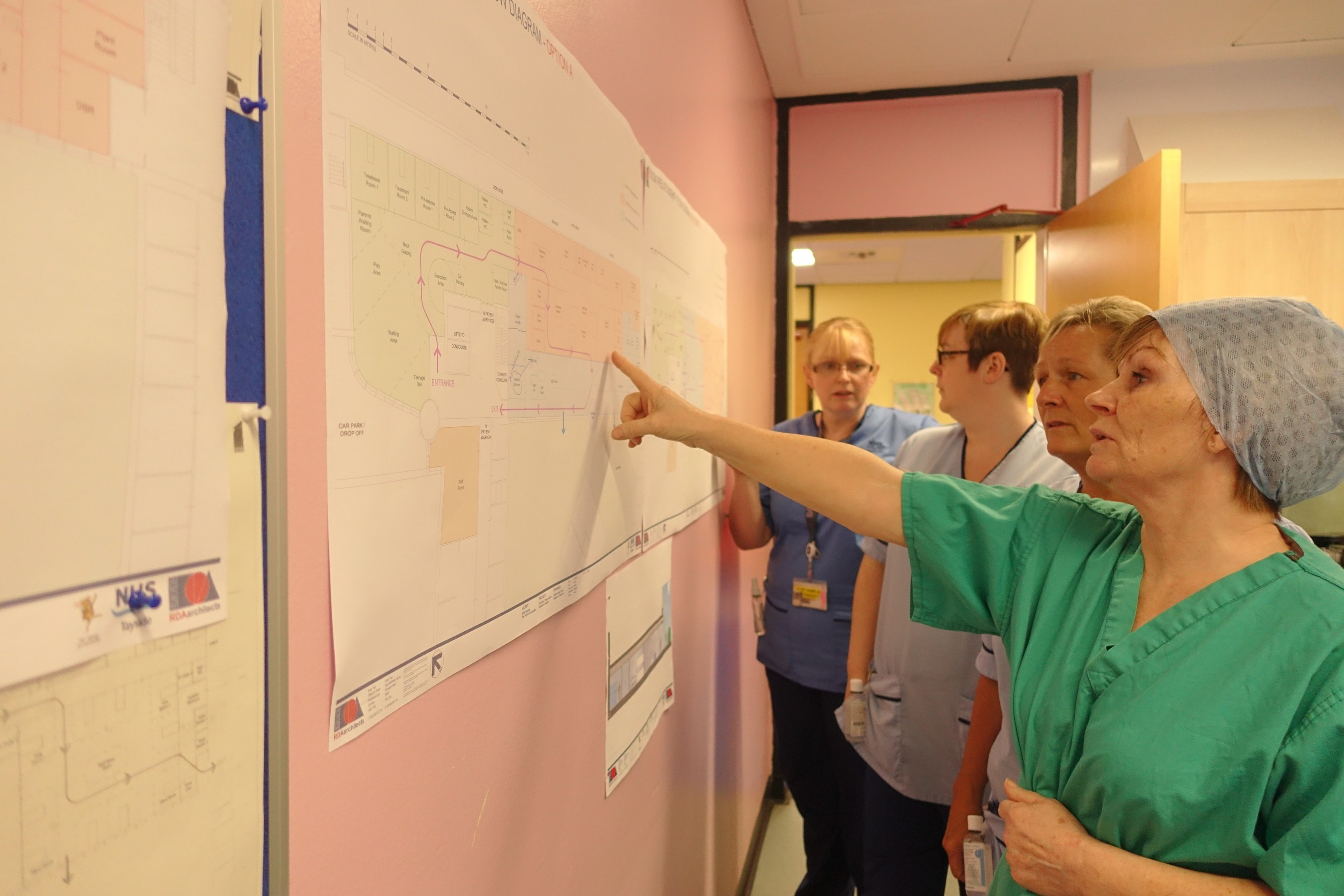 Staff of the children's surgical unit, Ward 30, review the proposals.
