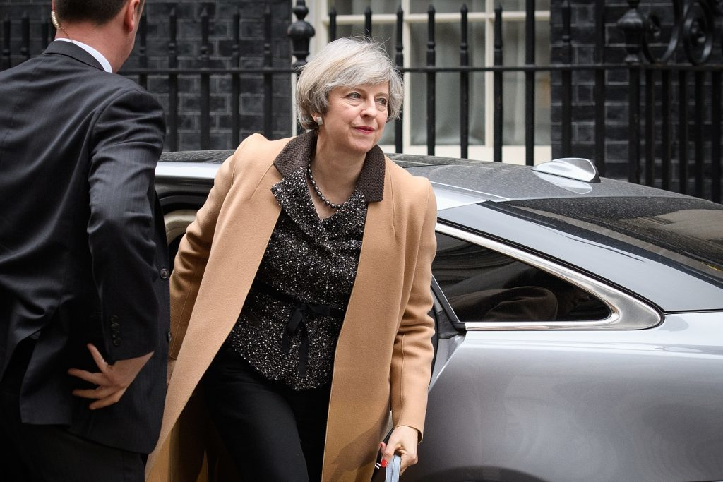 British Prime Minister Theresa May returns to number 10, Downing Street, after delivering a statement on the EU Council meeting, to the House of Commons on March 14,