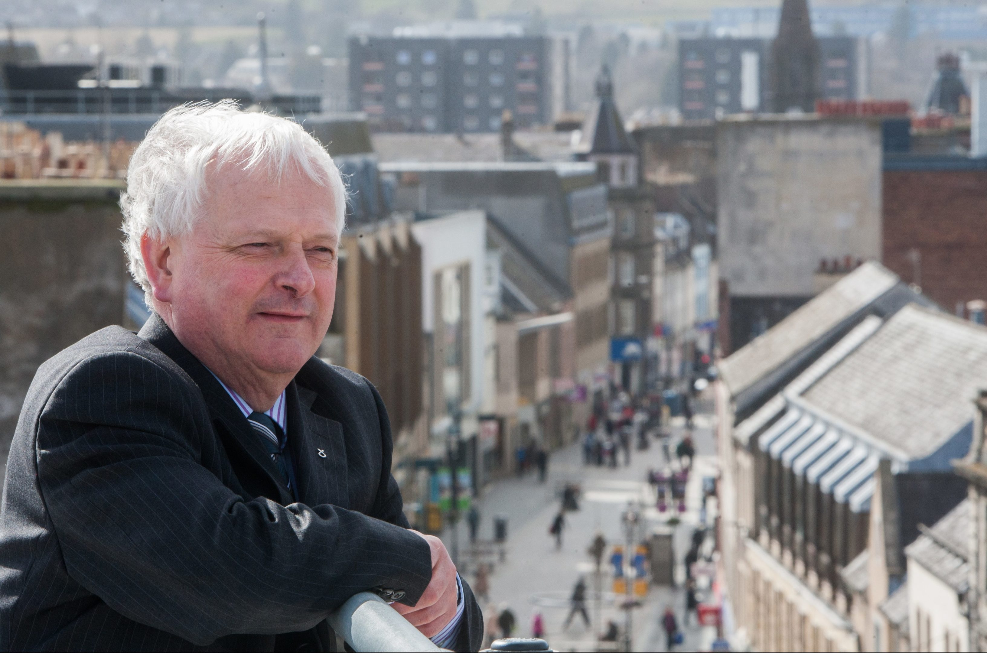 Councillor Ian  Miller with Perth High Street in the background.
