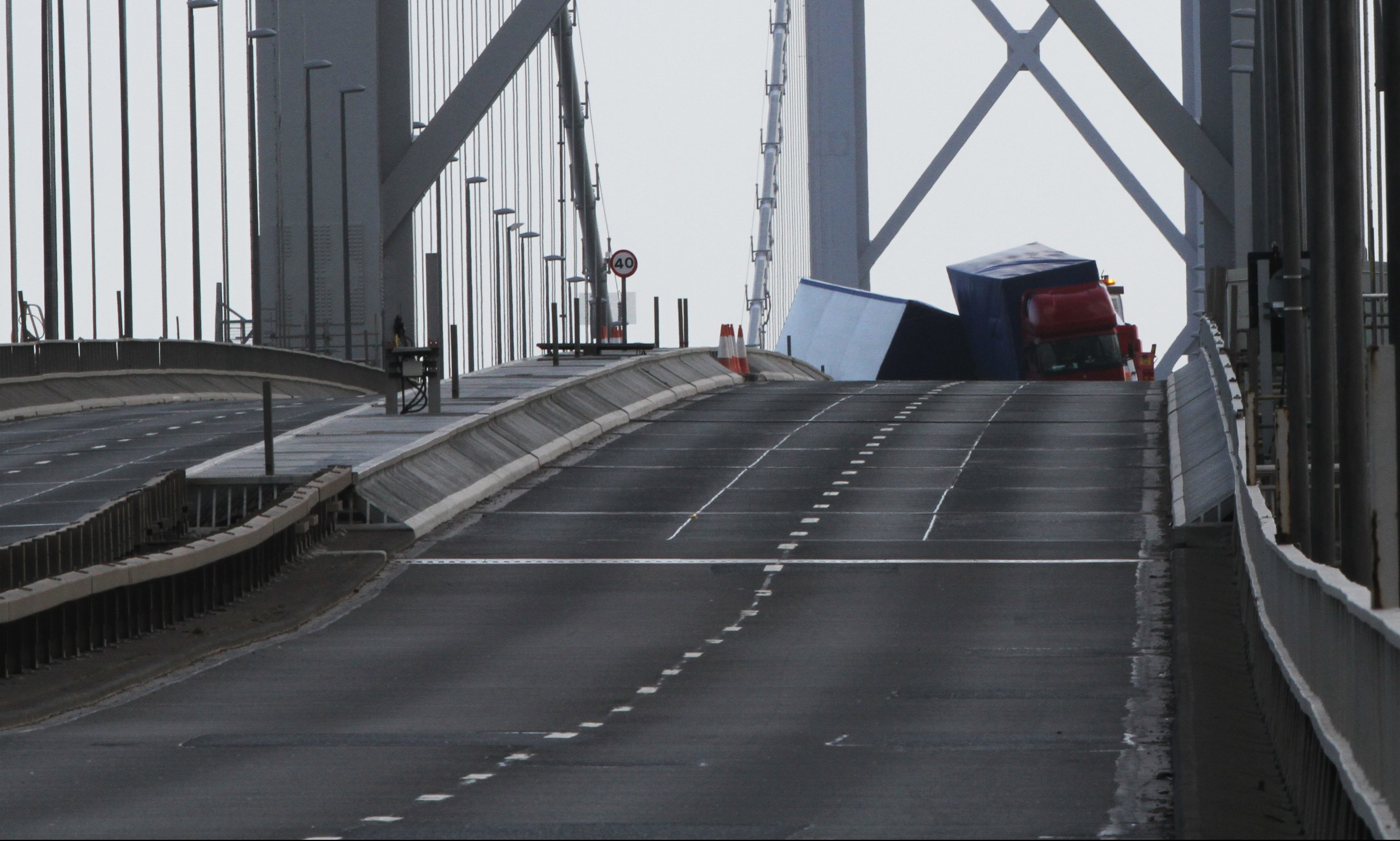 The overturned lorry on the deserted Forth Road Bridge.