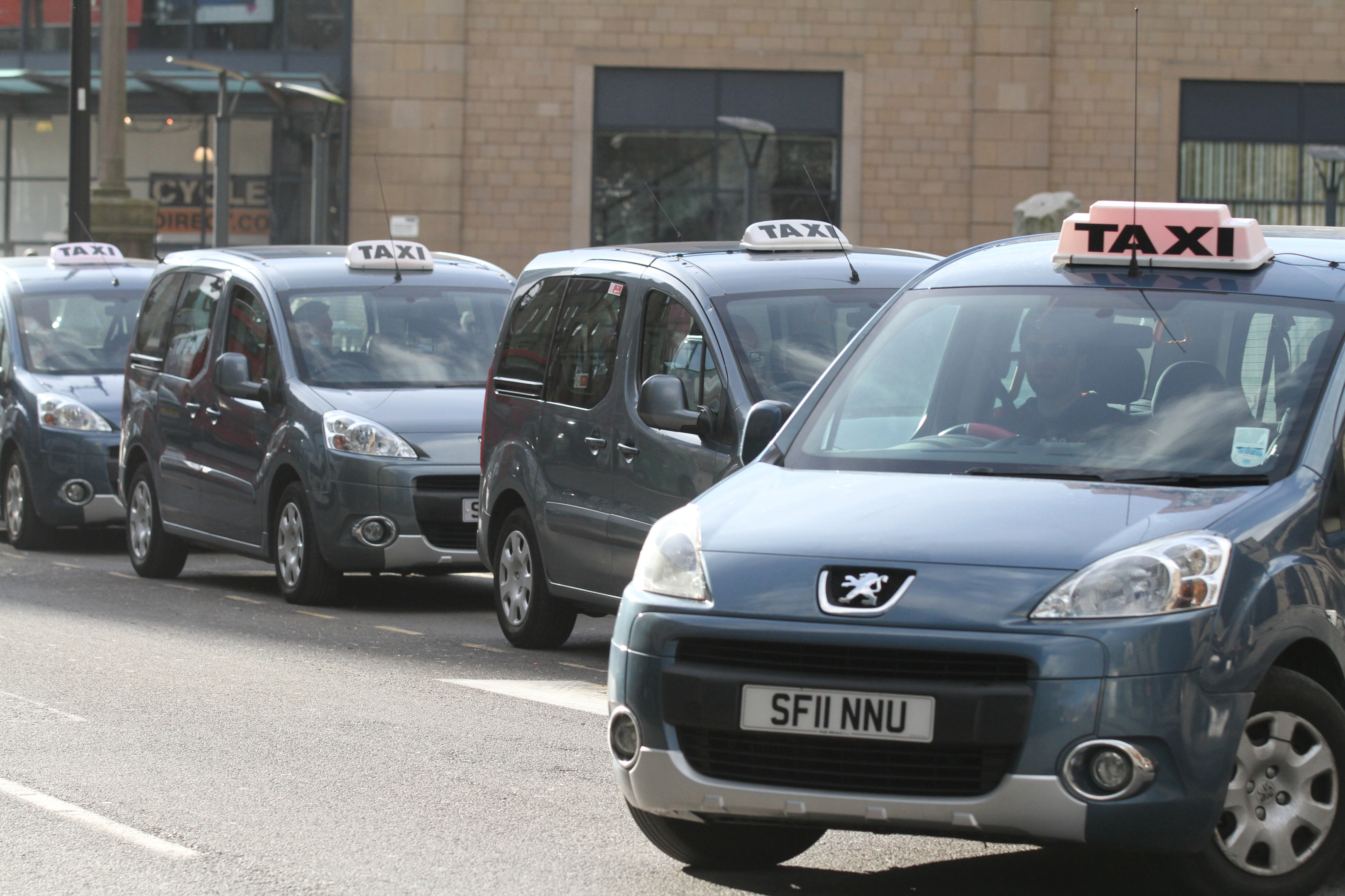 A taxi, similar to the ones pictured, was said to have been attacked on Friday night.