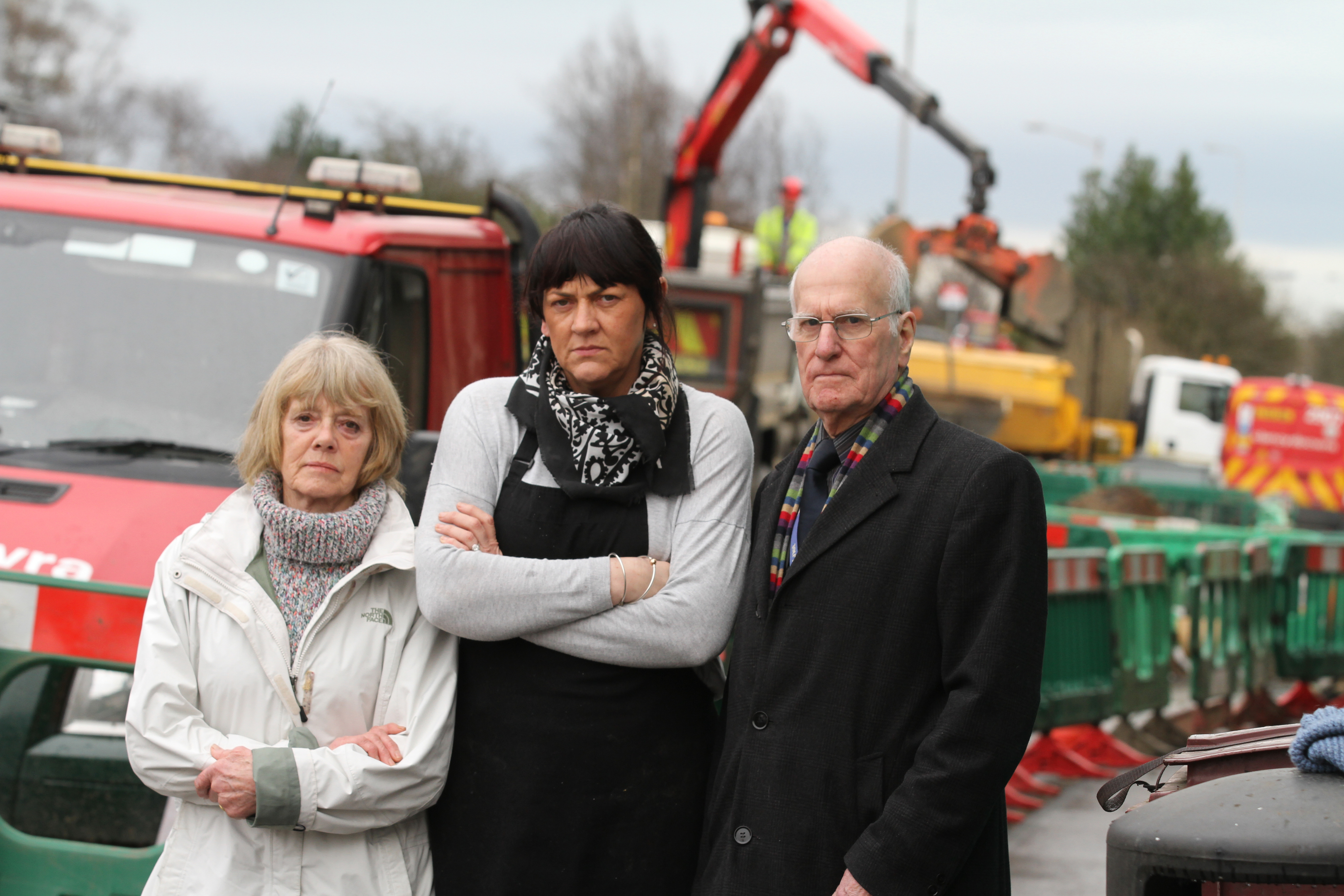 Local business owners Margaret Delmaestro, Jill Muir and local Thornton Councillor Ross Vettraino near the roadworks through the Main Street.