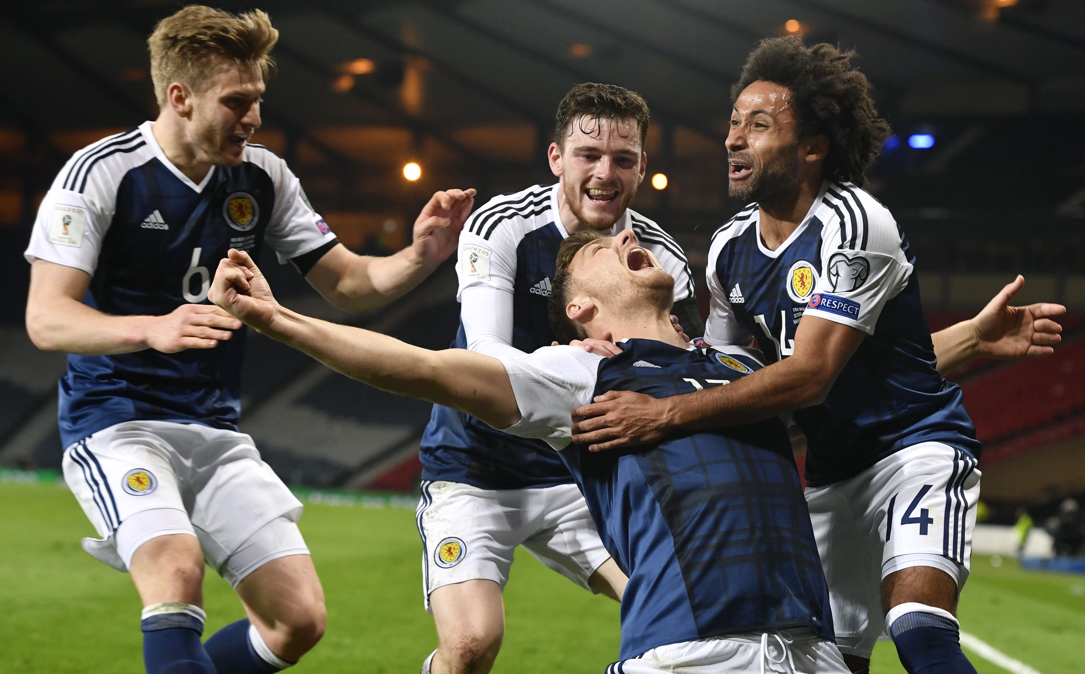 Scotland's Chris Martin celebrates his late goal with his team mates.
