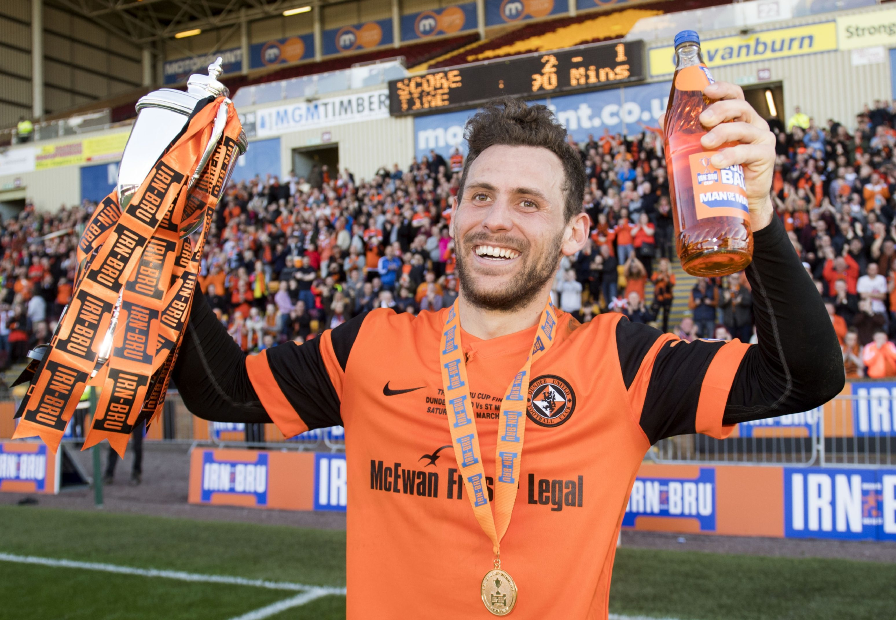 Tony Andreu celebrates with the cup.