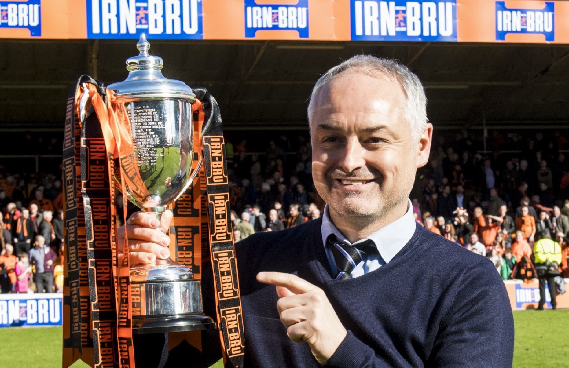 United boss Ray McKinnon with the cup.
