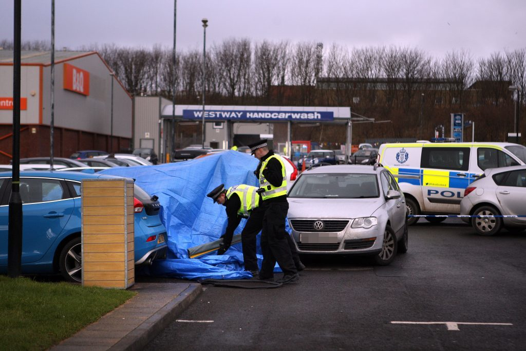 The tarpaulin-covered Mercedes in the McDonalds car park.
