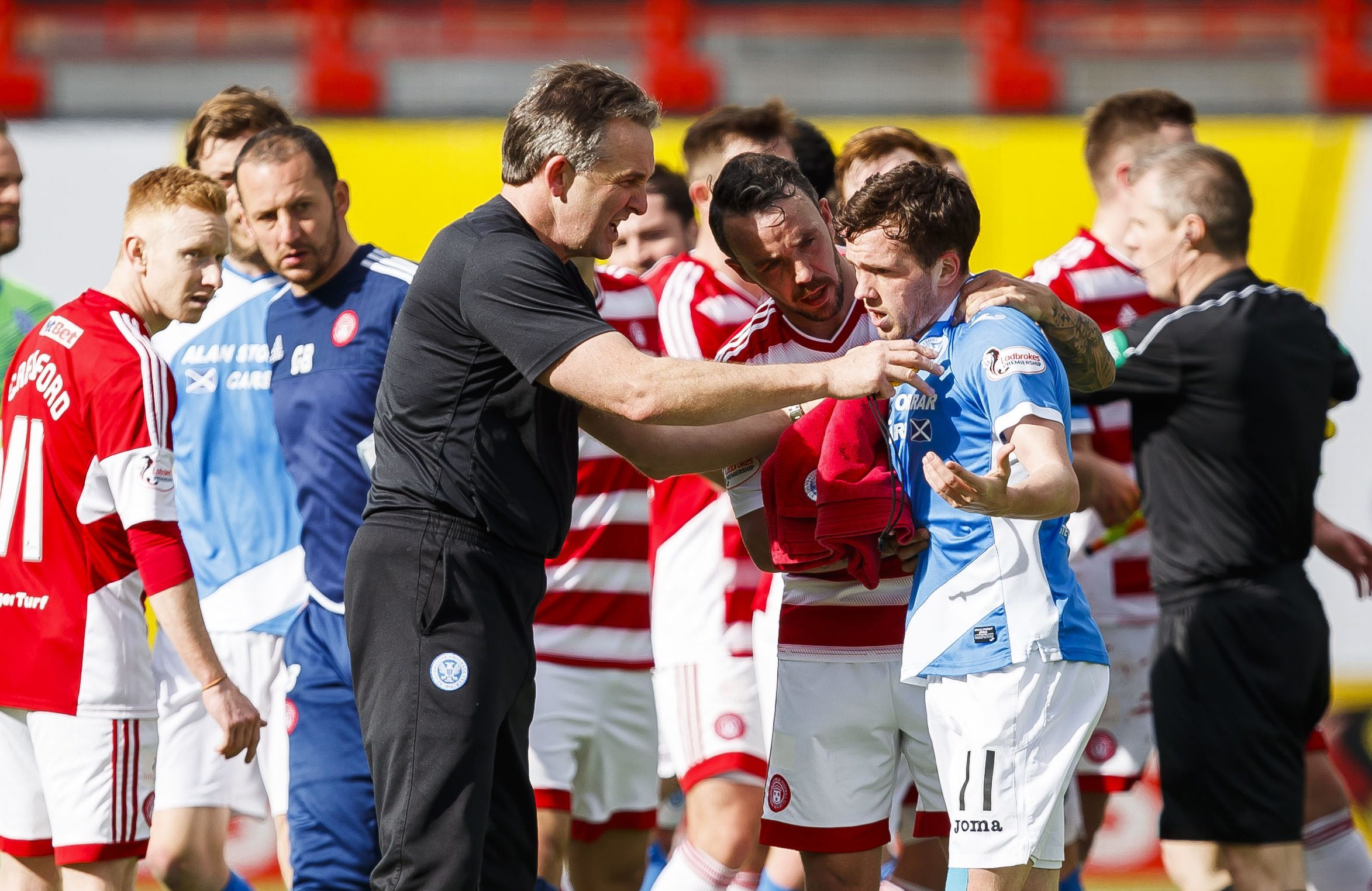 The half-time scene as Saints staff and Hamilton players attempt to calm Danny Swanson.