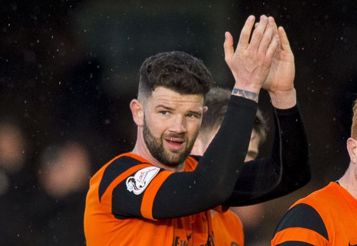 Dundee United's Mark Durnan and Simon Murray at full-time.