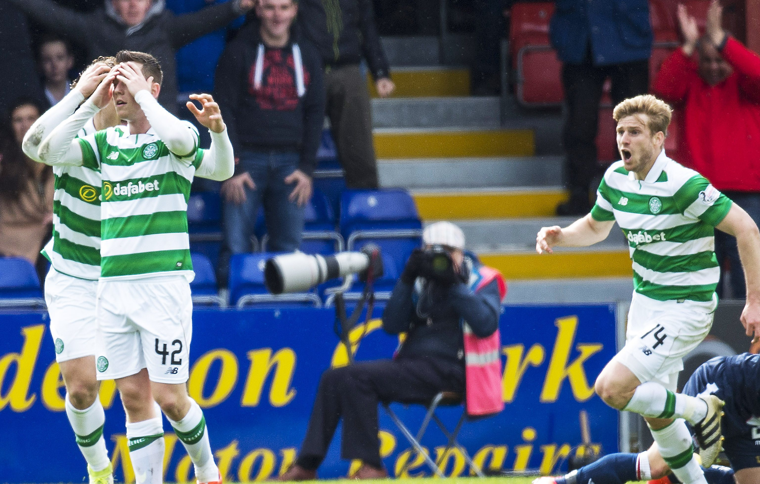The Celtic players show what they think of Alex Schalk's dive.