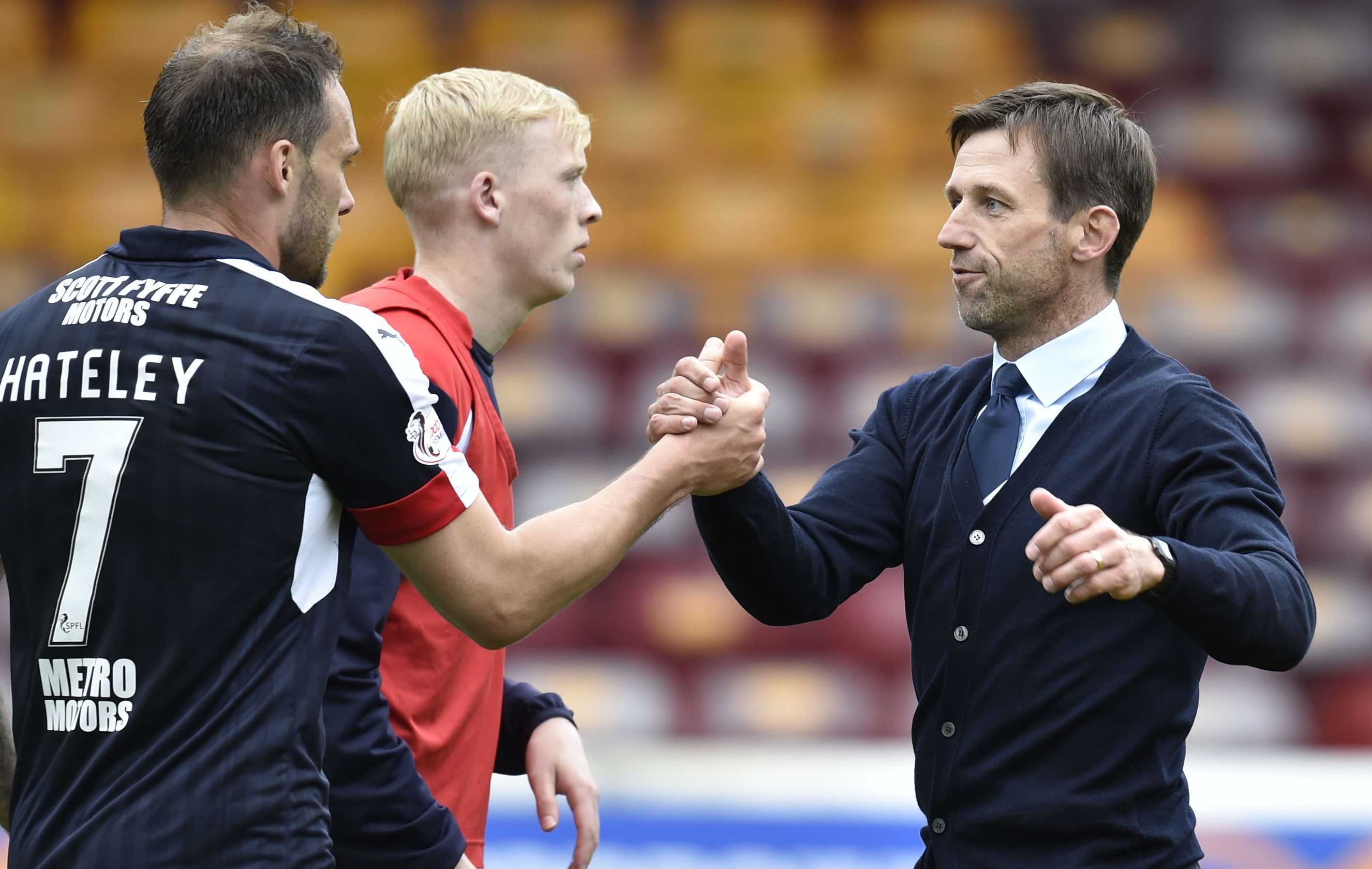 Dundee interim manager Neil McCann celebrates at full time with Tom Hateley.