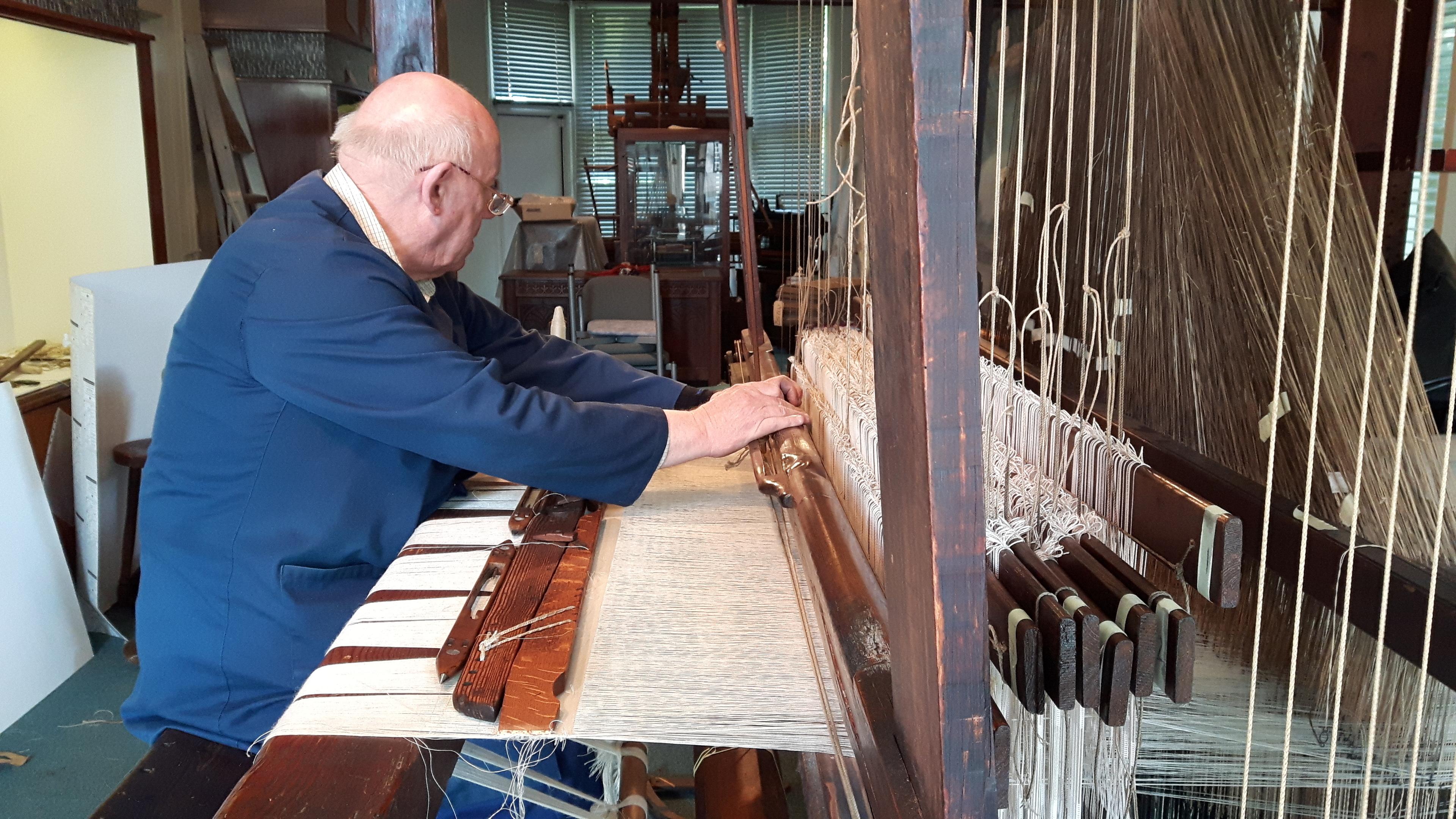Ian Dale operating the historic loom.
