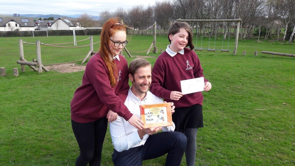 Northmuir deputy head Jonathan Brown with Issy (left) and Charley