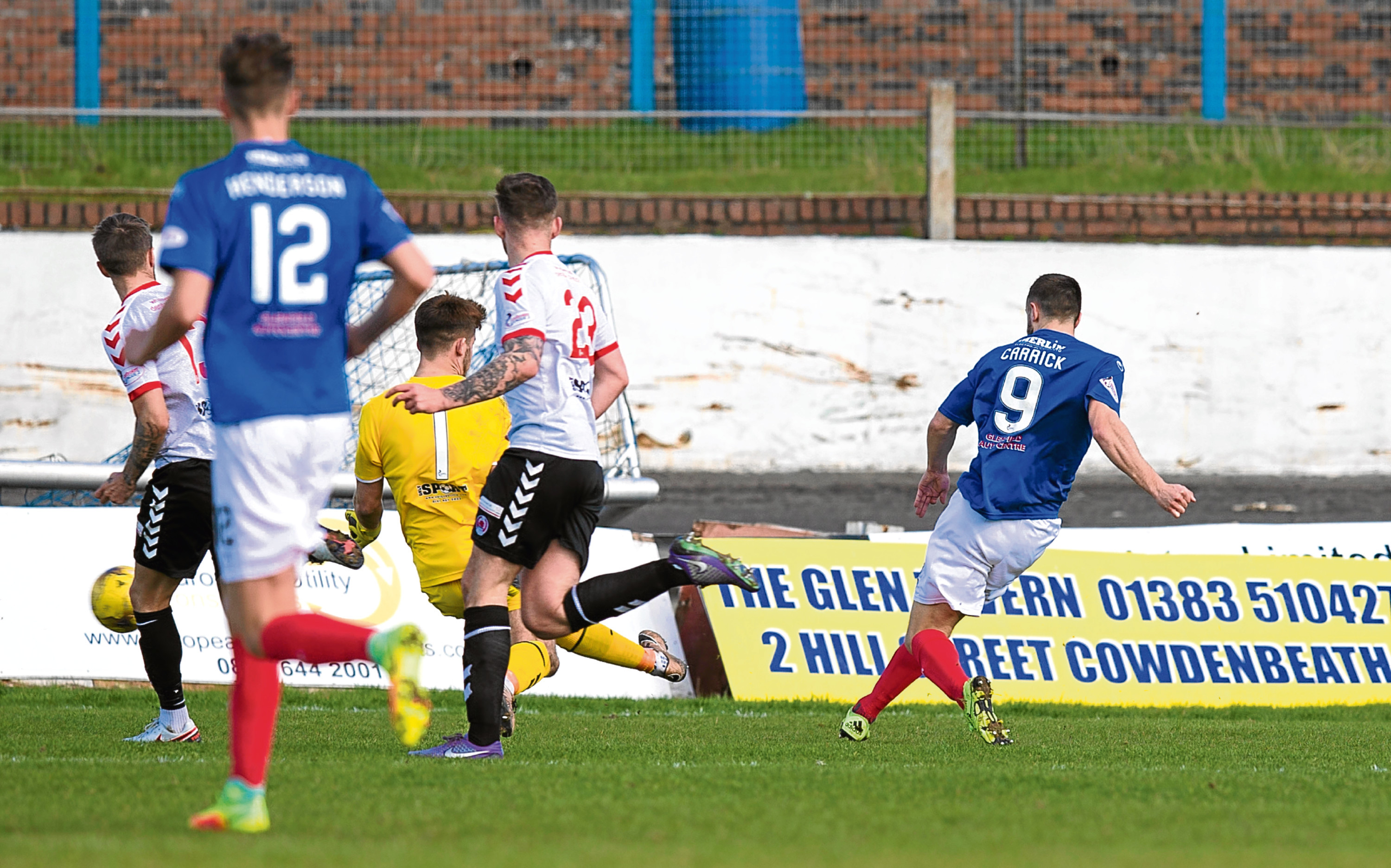 Cowdenbeath's Dale Carrick (right) opens the scoring.
