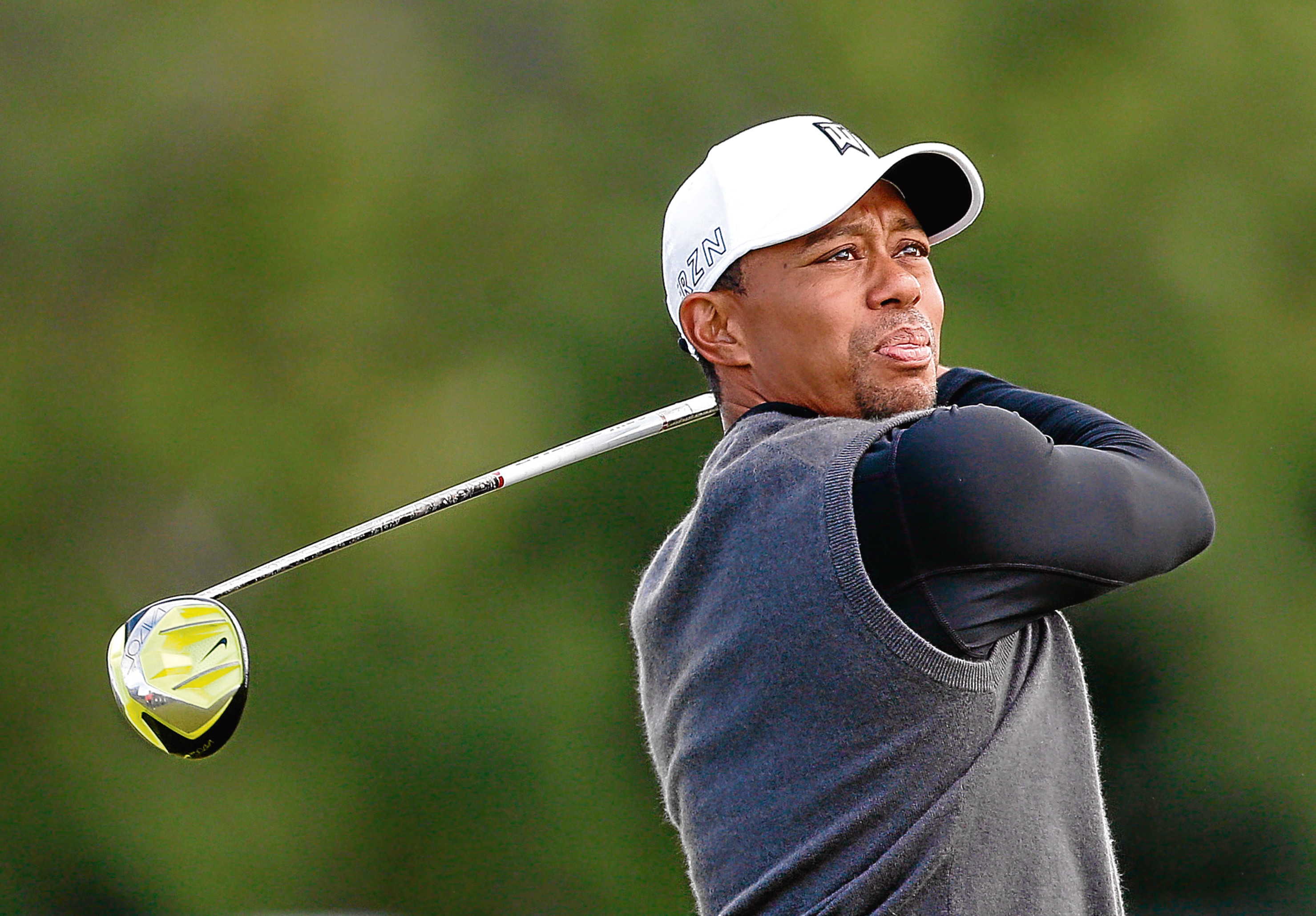 Tiger Woods flew into Dundee yesterday