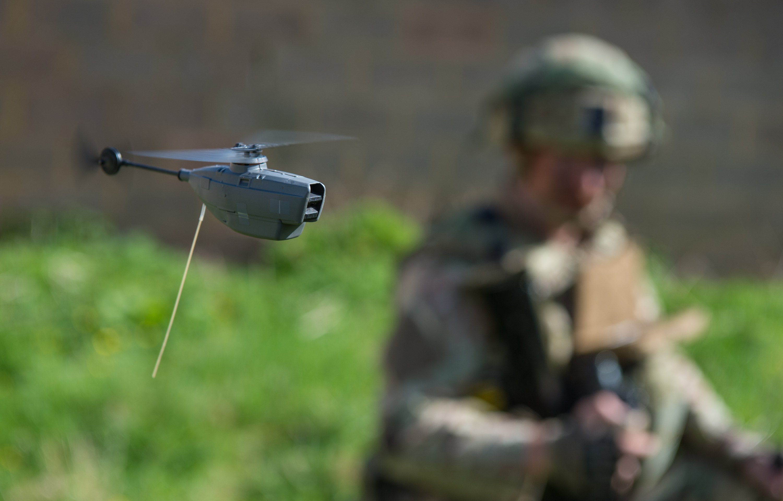 Royal Marine flies a Black Hornet 2 Unmanned Air System.