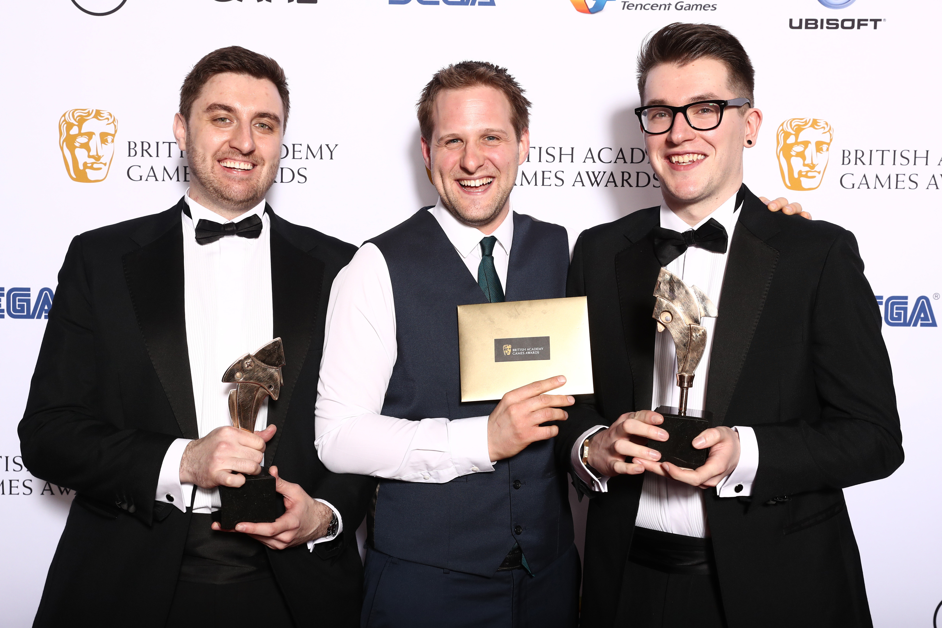 The Bluedoor Games team (L-R) Lukasz Gomula, Ashton Mills and Roberto Macken, celebrate their BAFTA win.