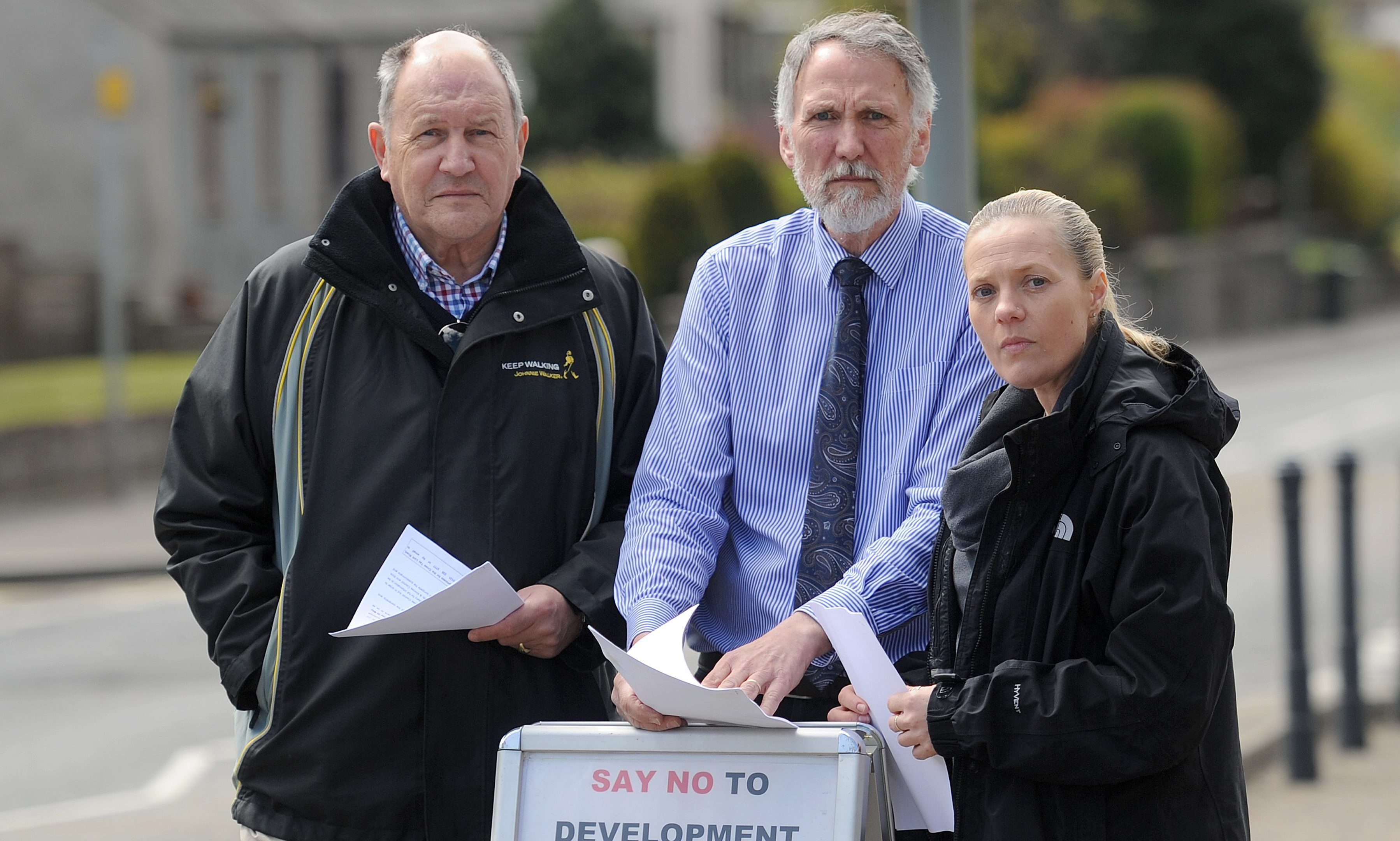 Members of Scone community council are unhappy that PKC is conducting a questionnaire about the proposed Cross Tay Link Road. Picture shows l to r - Martin Rhodes (Scone Community Council), Councillor Lewis Simpson and Lisa Cardno, Perth Road, Scone.