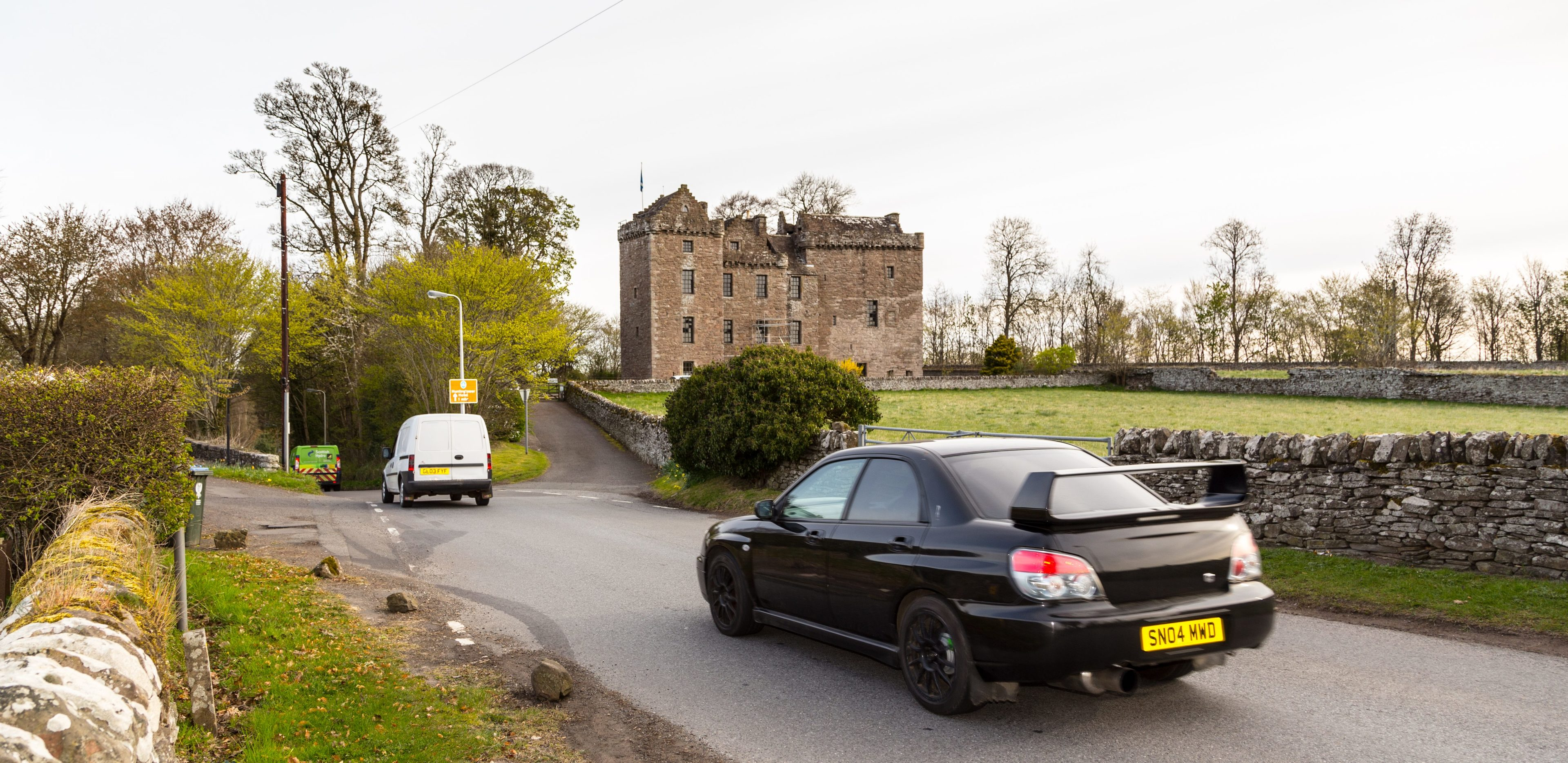 A motorist using the 'rat run'past Huntingtower Castle.