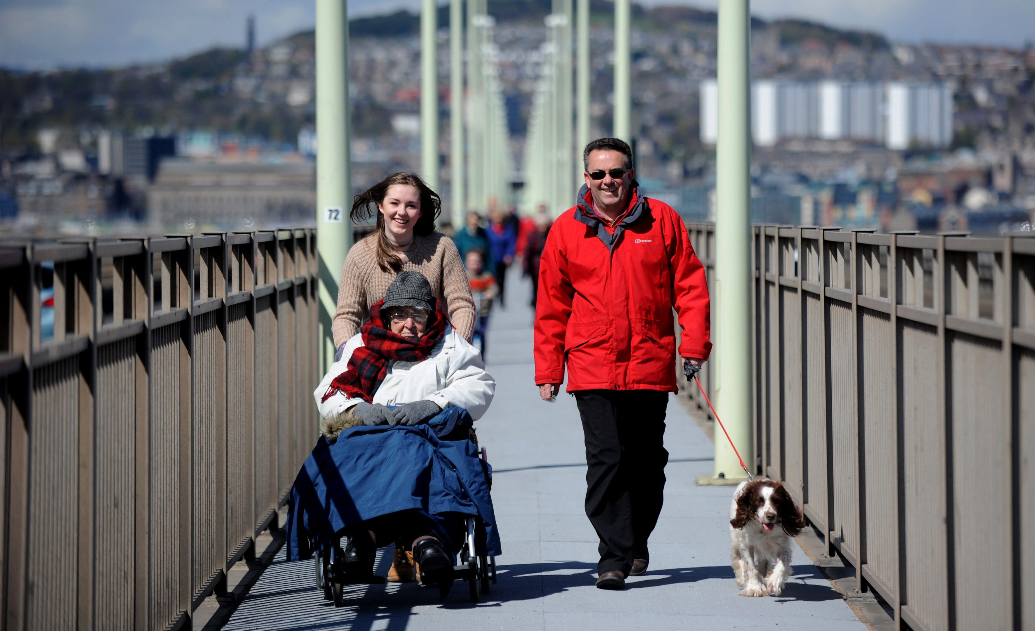 Douglas Tucker taking part with his grand daughter Annie and son Peter in last years Christian Aid Tay Bridge walk.