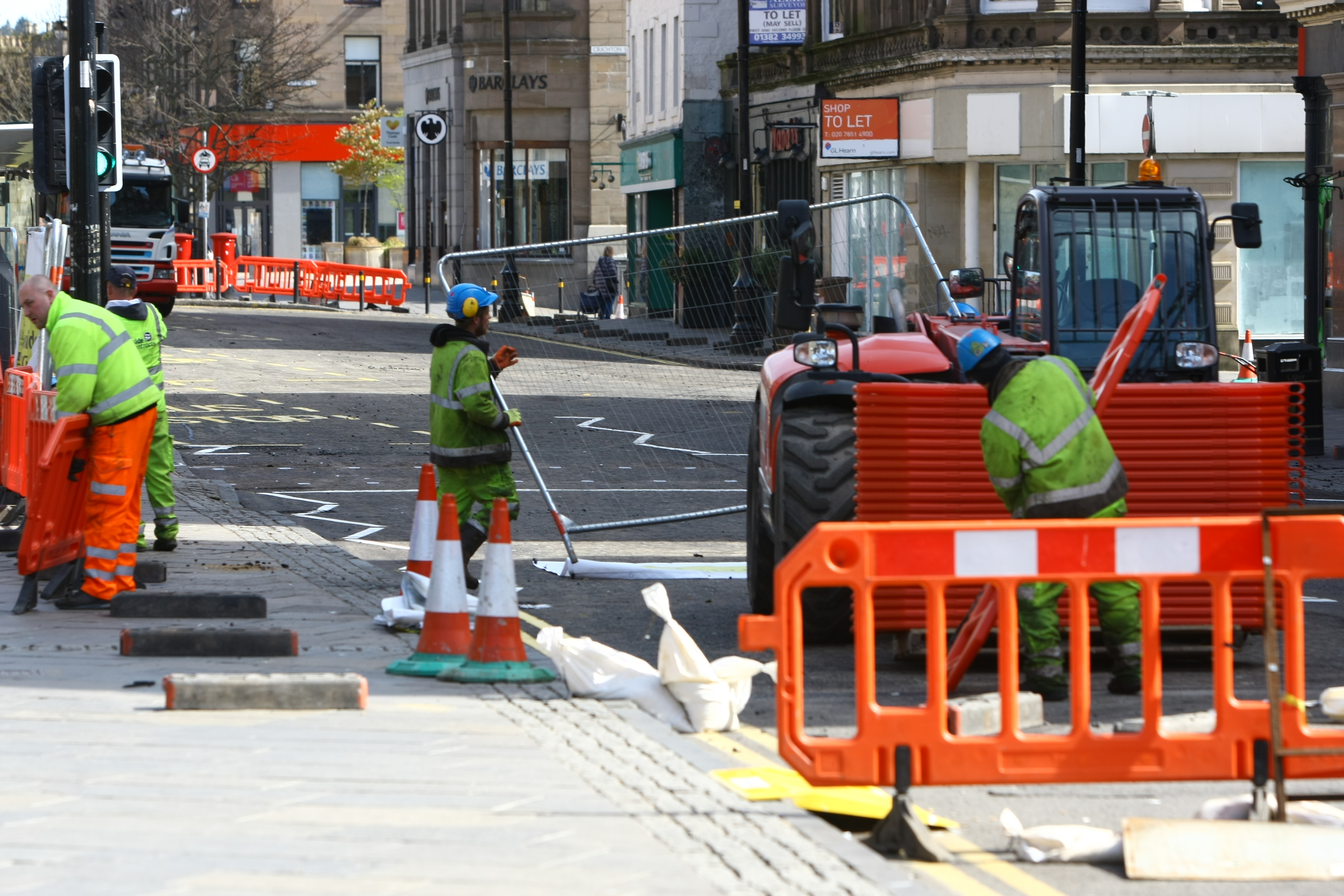 Final clear-up at the site of the roadworks.