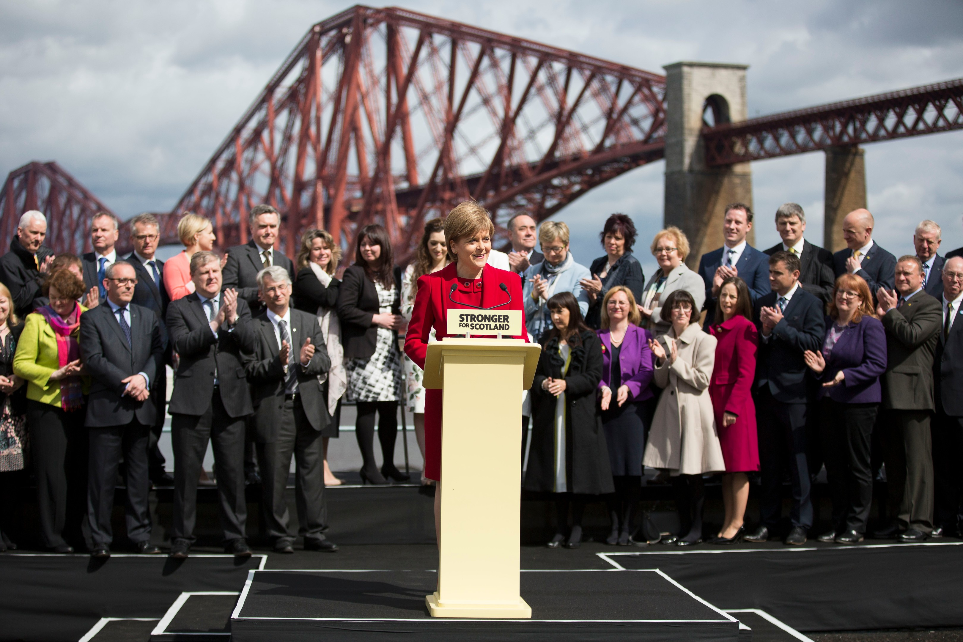 Scotlands First Minister and SNP leader presents the 56 MPs who won seats in the General Election in front of the iconic Forth Rail Bridge in South Queensferry Scotland  Photograph by James Williamson
