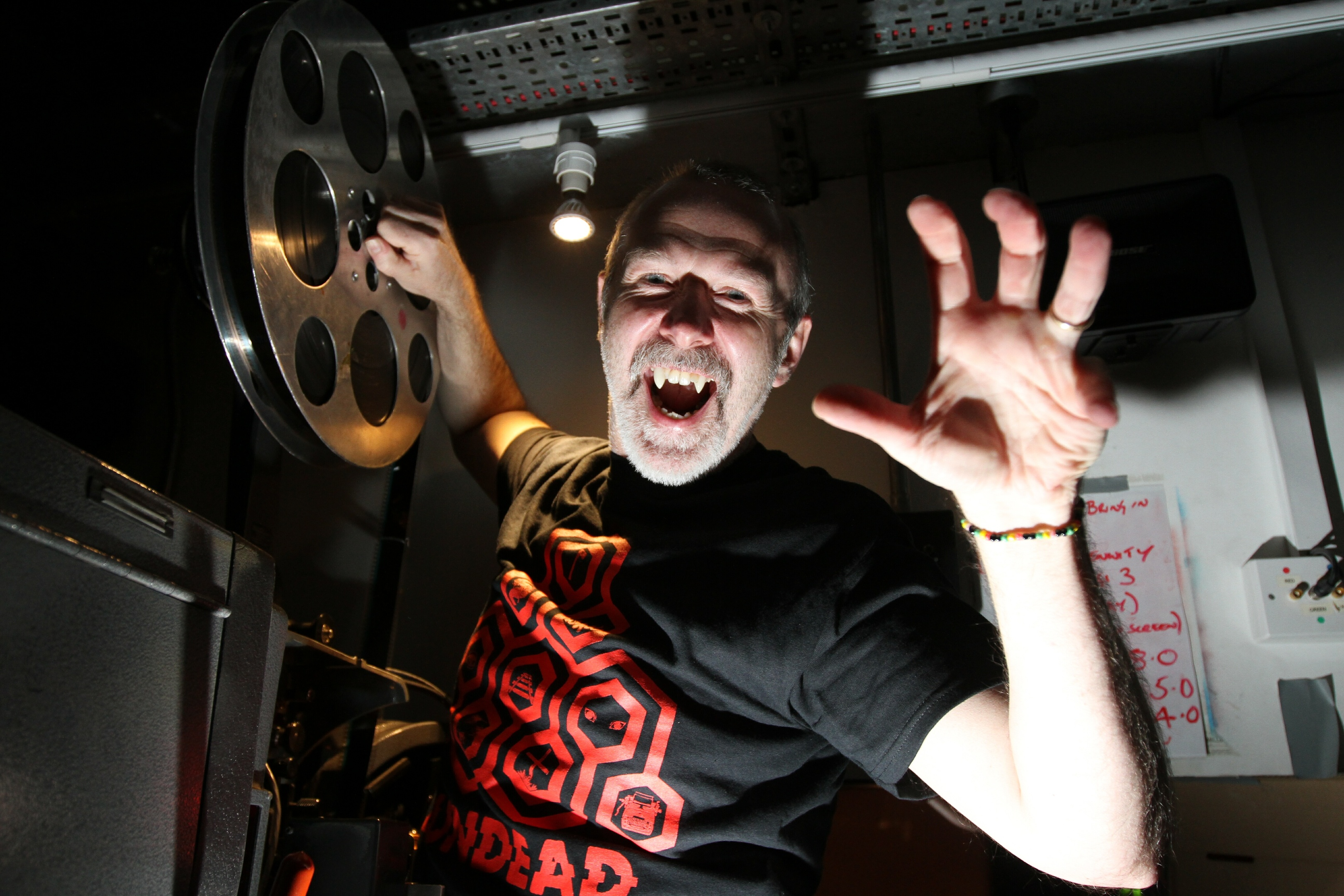 Head projectionist Ian Banks puts the first film reel on the projector
