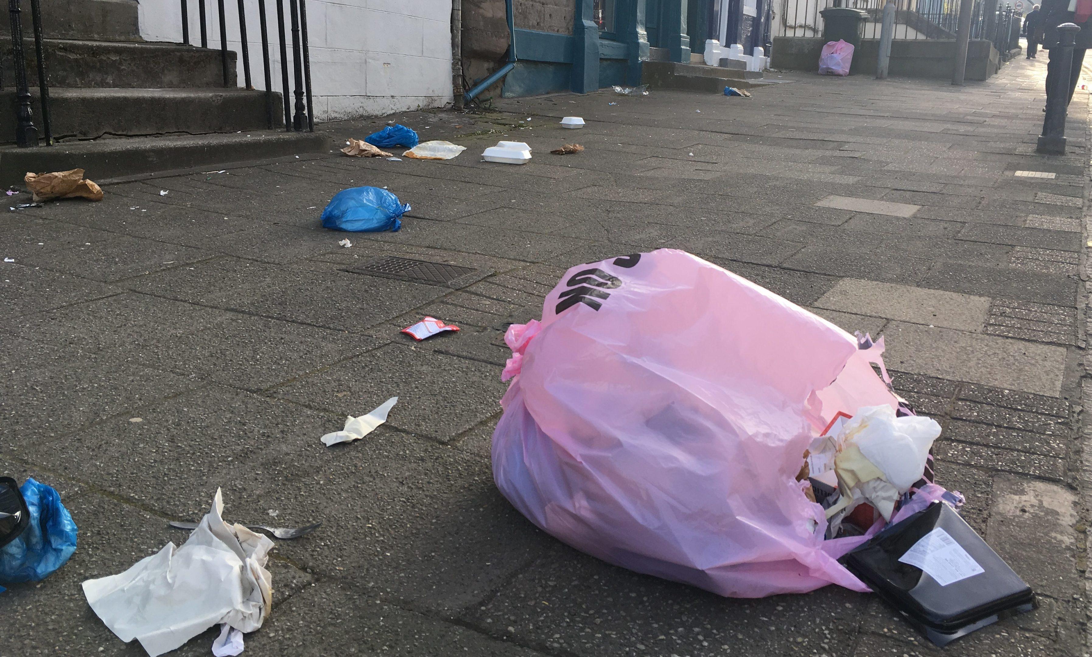 Rubbish strewn across Charlotte Street, Perth.
