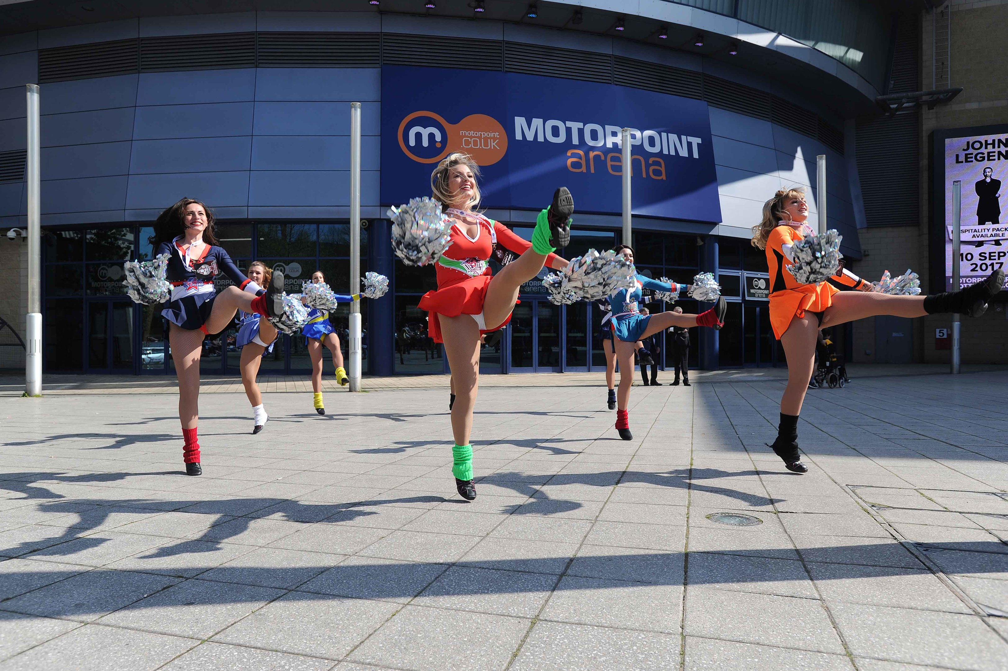 Cheer leaders greet fans arriving at the Motorpoint Arena.