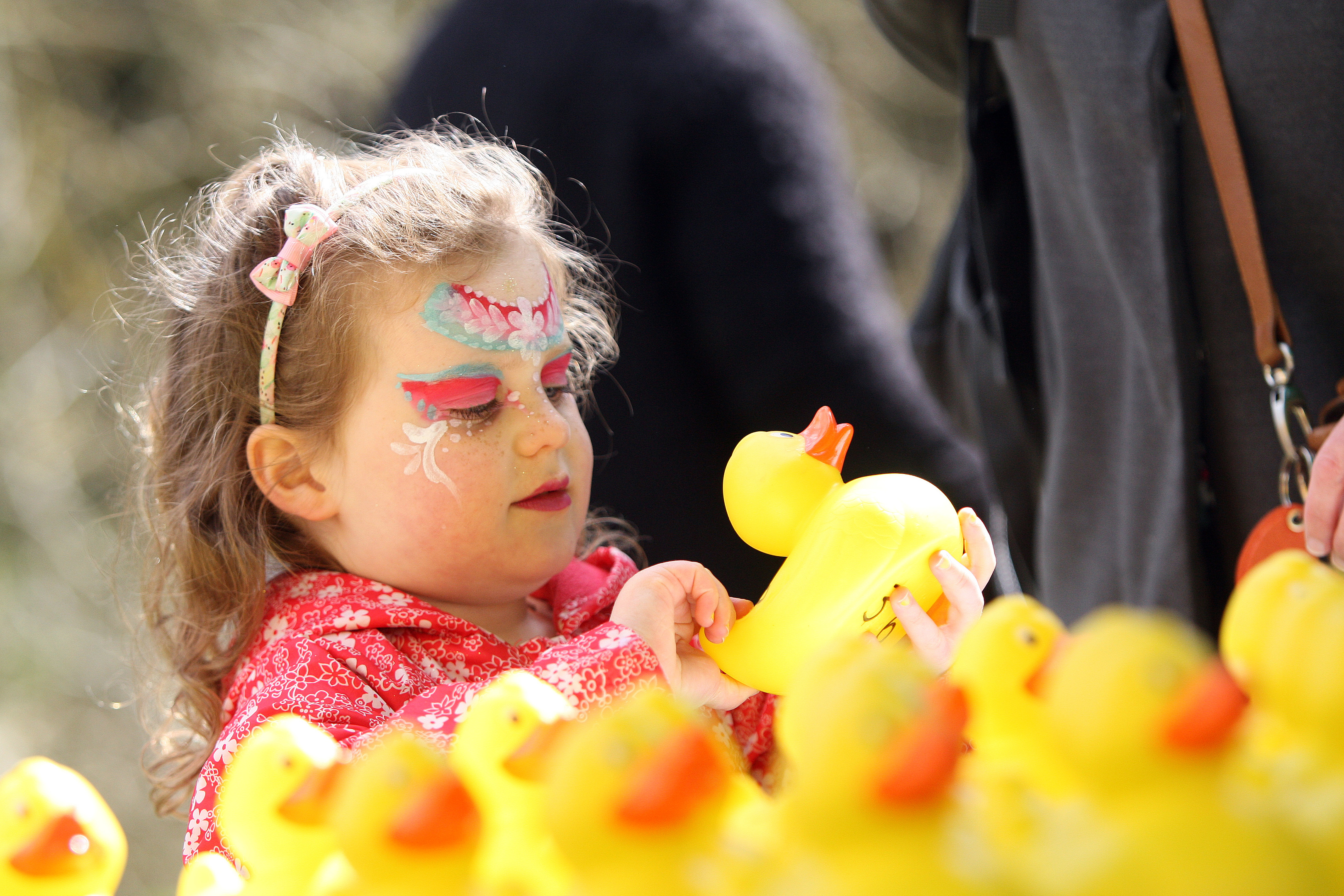Erin Durcan carefully selecting her duck at  Barry Mill Easter Duck race and fun day