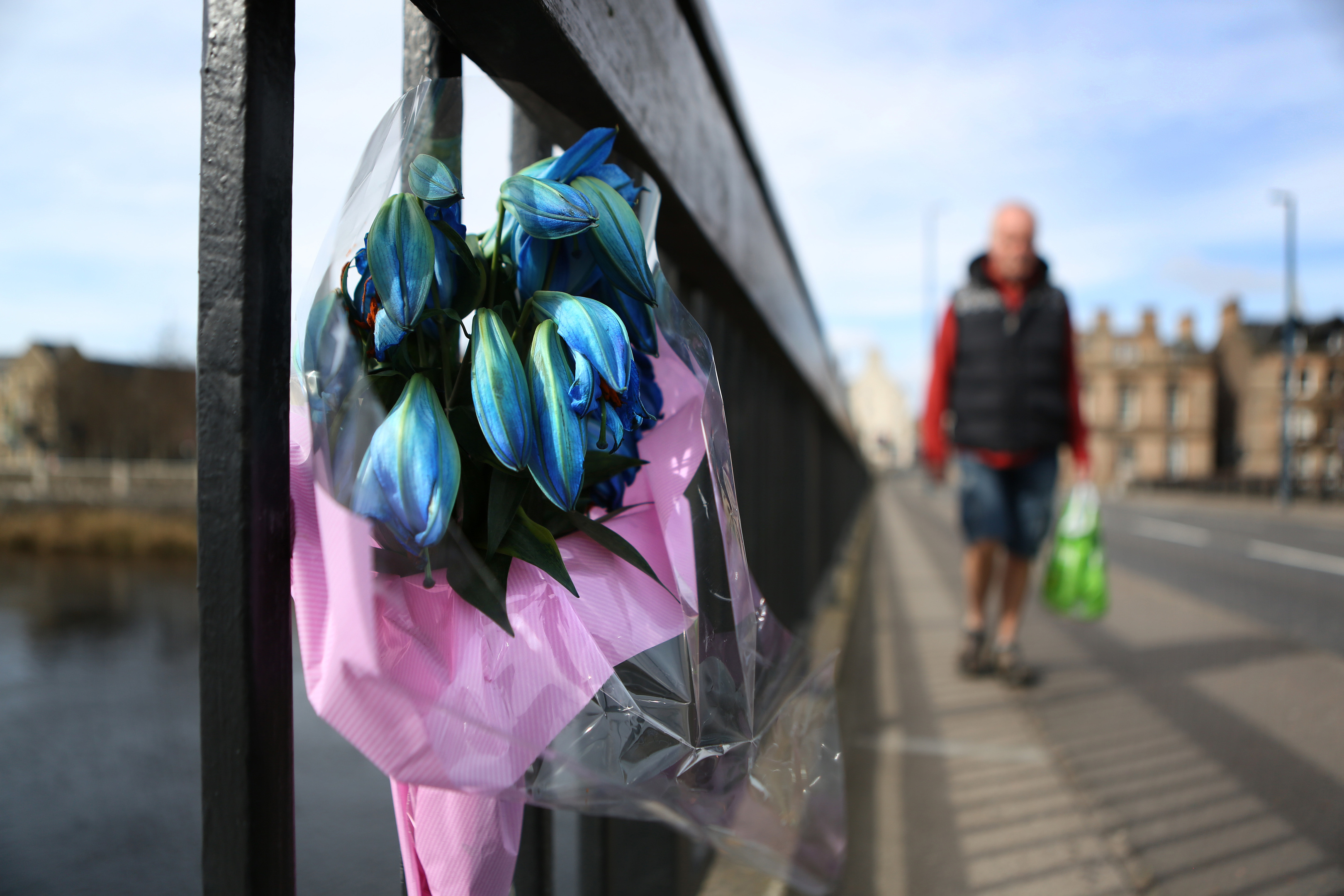 A floral tribute was left on  Perth's, Queen's bridge with a note to Kieran.