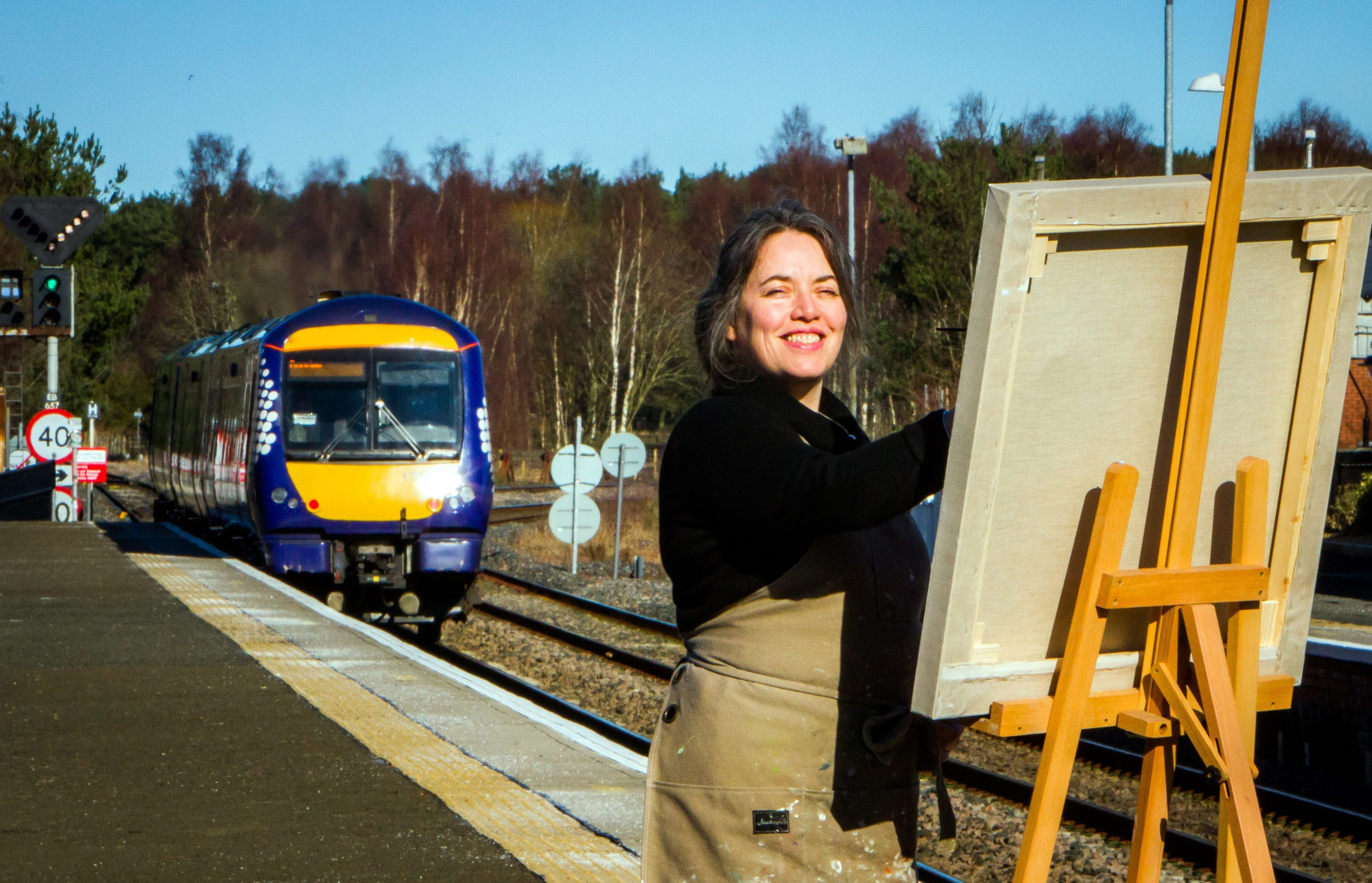 Kirsty Lorenz painting at Ladybank Station where she has a studio