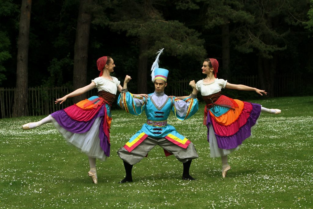 """Making the most of the lawns! The JSLN Dance Company, from Germany, were rehearsing in the Botanic Gardens in St. Andrews last June, ahead of their performance of """"Variations Of Pointe"""" which they performed as part of the Byre In The Botanics season. Picture shows dancers Attila Kiss with Caroline Rees and Estelle Botella."""