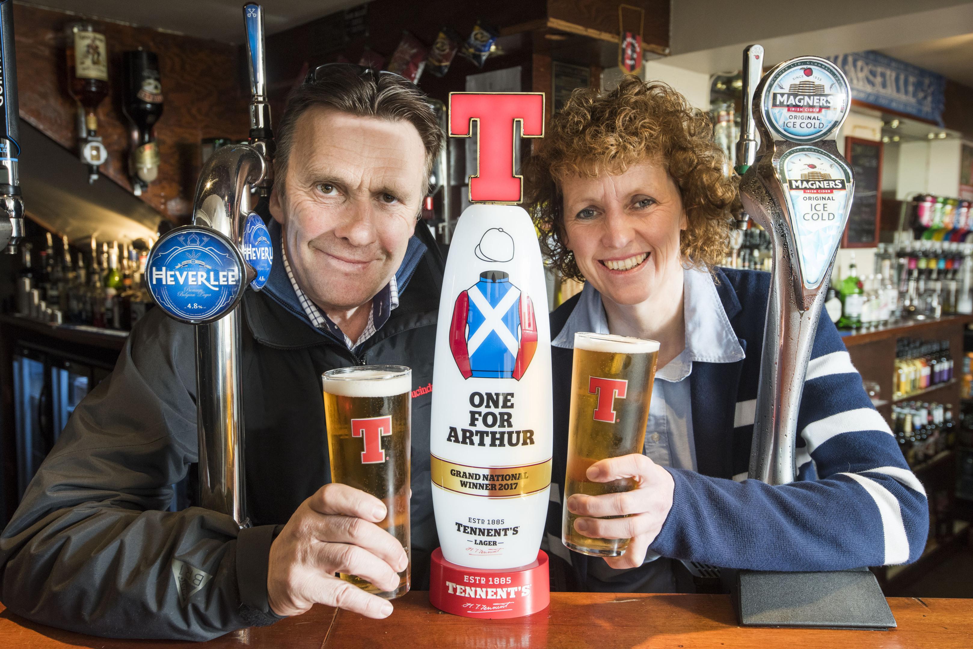 "Lucinda Russell and Peter Scudamore with the Tennents special ""One For Arthur"" tap at the Thistle Hotel in Milnathort"