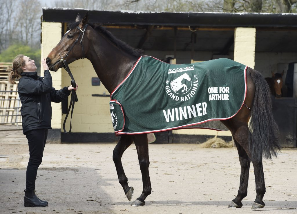 Grand National winner One For Arthur is paraded by stable girl Jaimie Duff.