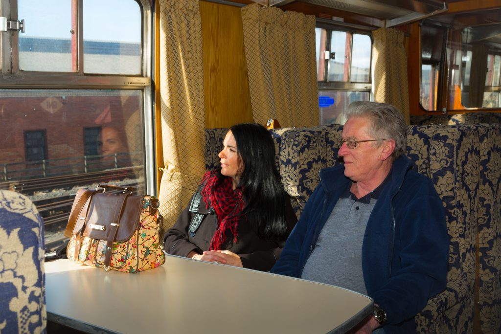 Gayle and Jim Paterson enjoy a trip on a steam train.