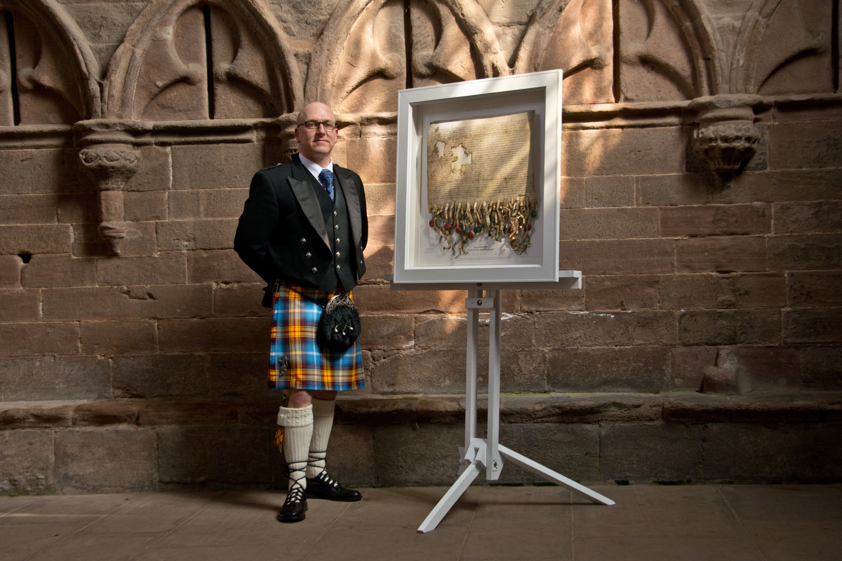 Artist Steven Patrick Sim with his replica of The Declaration of Arbroath at Arbroath Abbey.