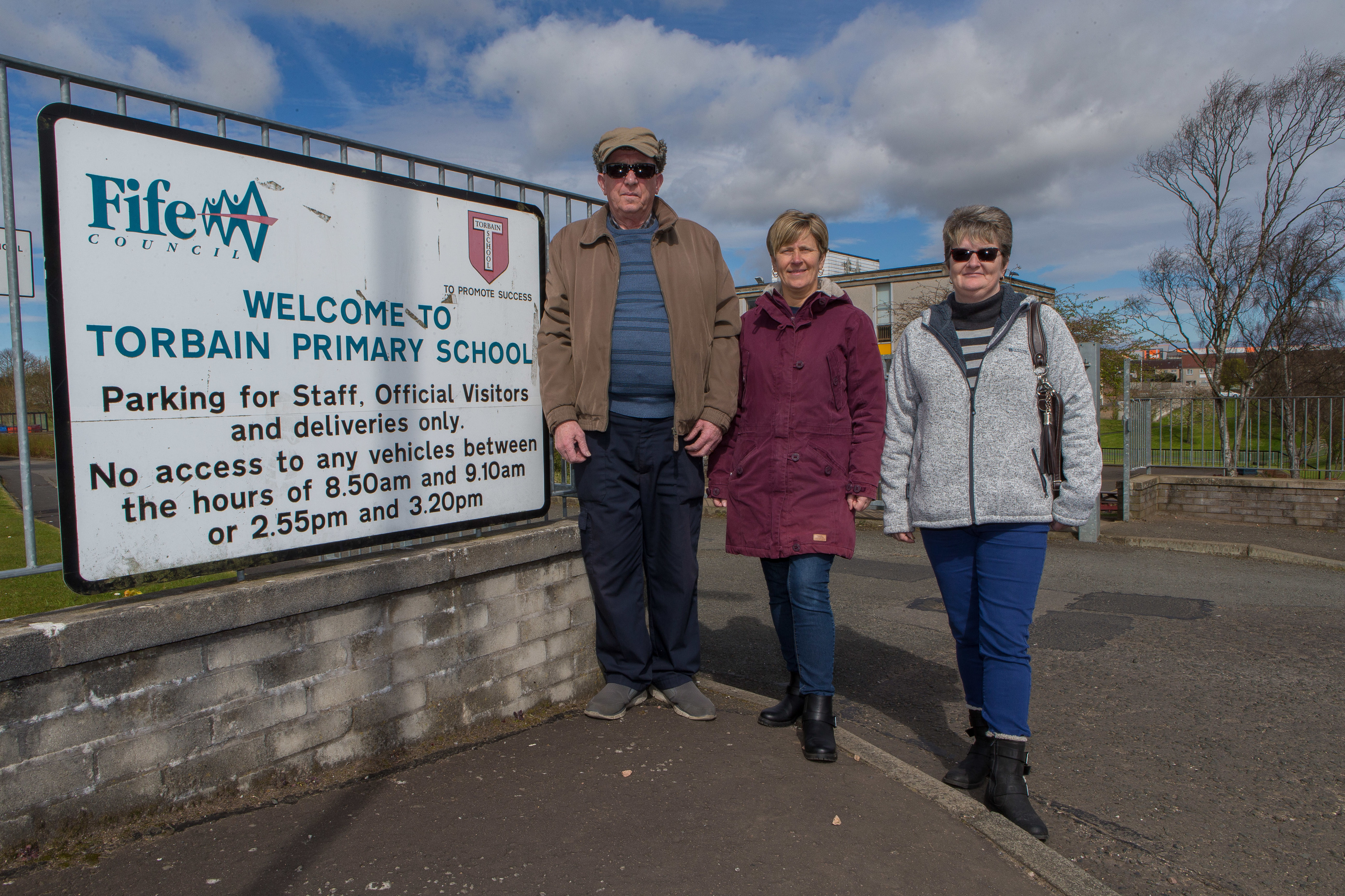 From left, Frank Brown,  Karen Shand and Sharon Reynolds from Dallas Drive Tenants and Residents Association outside Torbain Primary School.