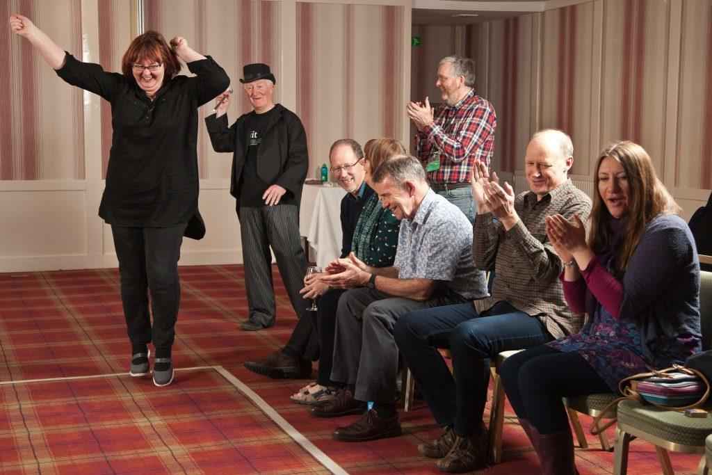 Irene Paterson celebrates her winning puff of the matchbox.